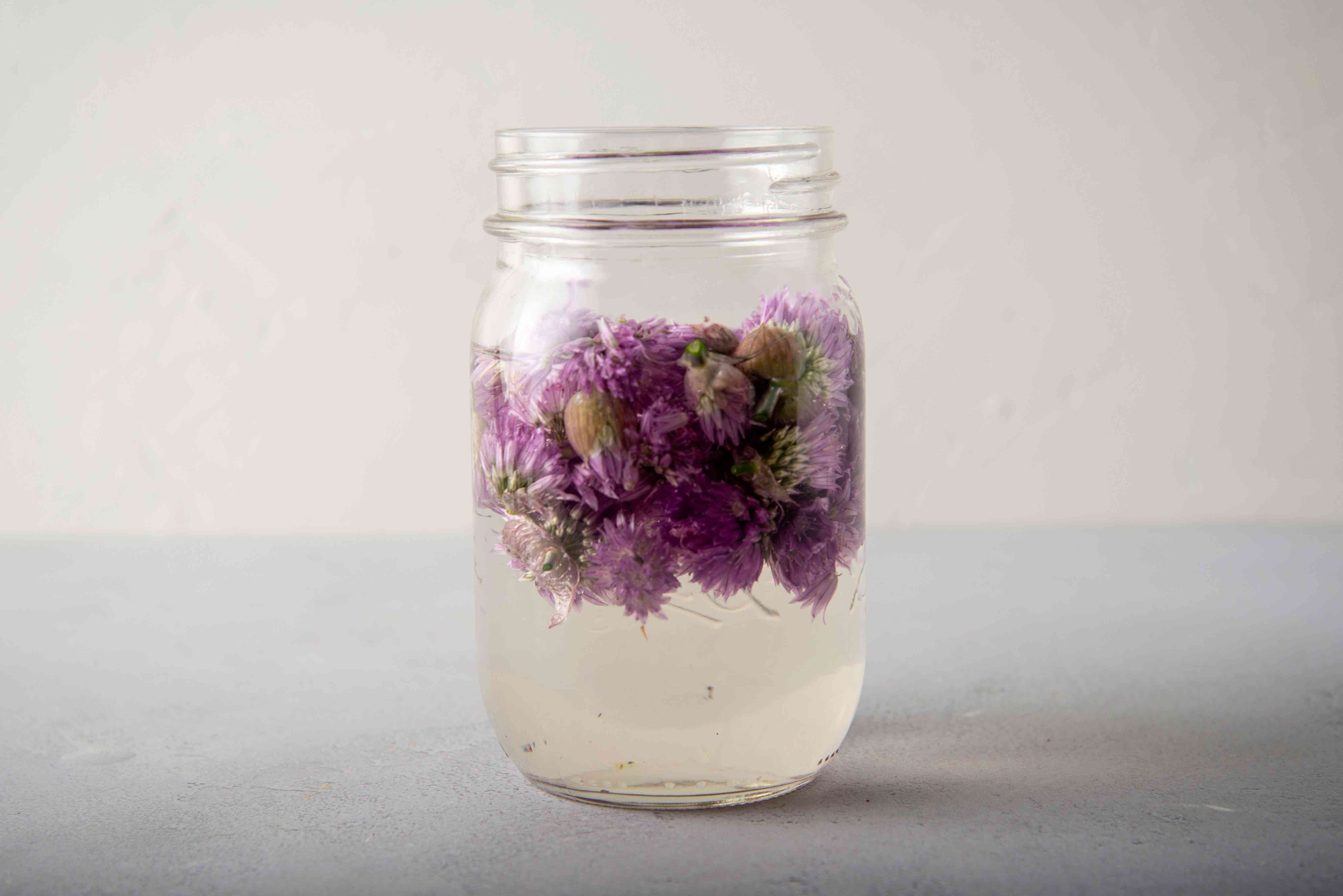 chive blossoms in vinegar in jar