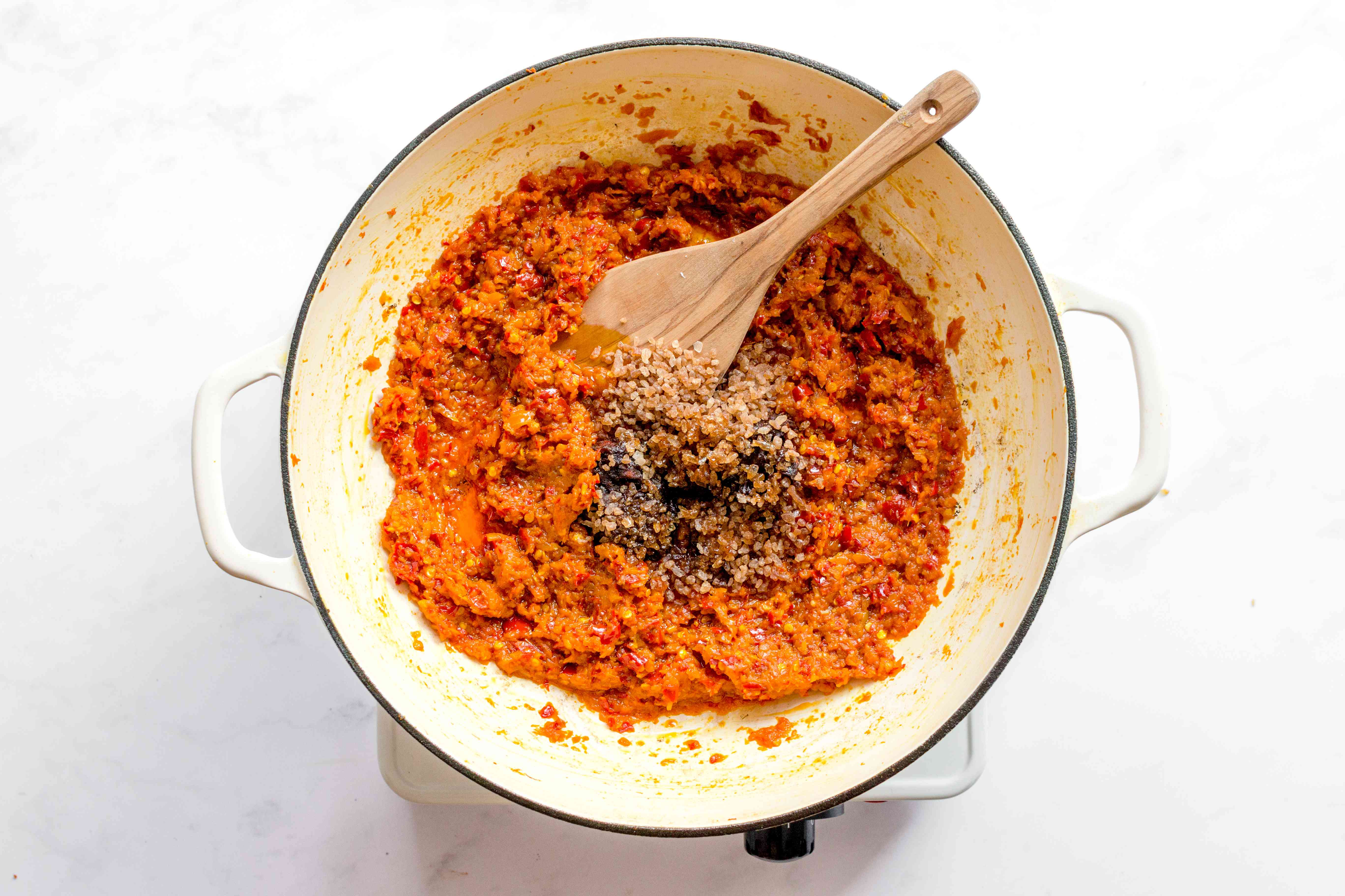 add the fish sauce, palm sugar, and tamarind paste to sauce in skillet