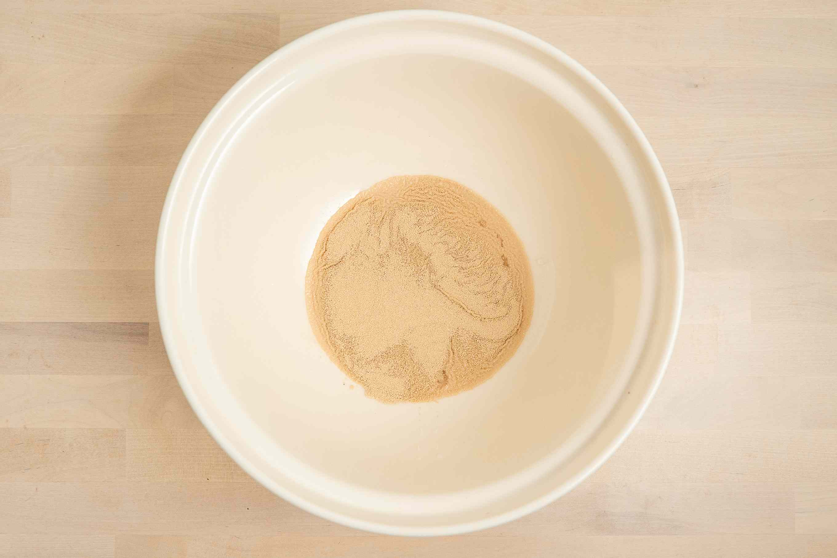 sprinkle yeast over the water in a bowl