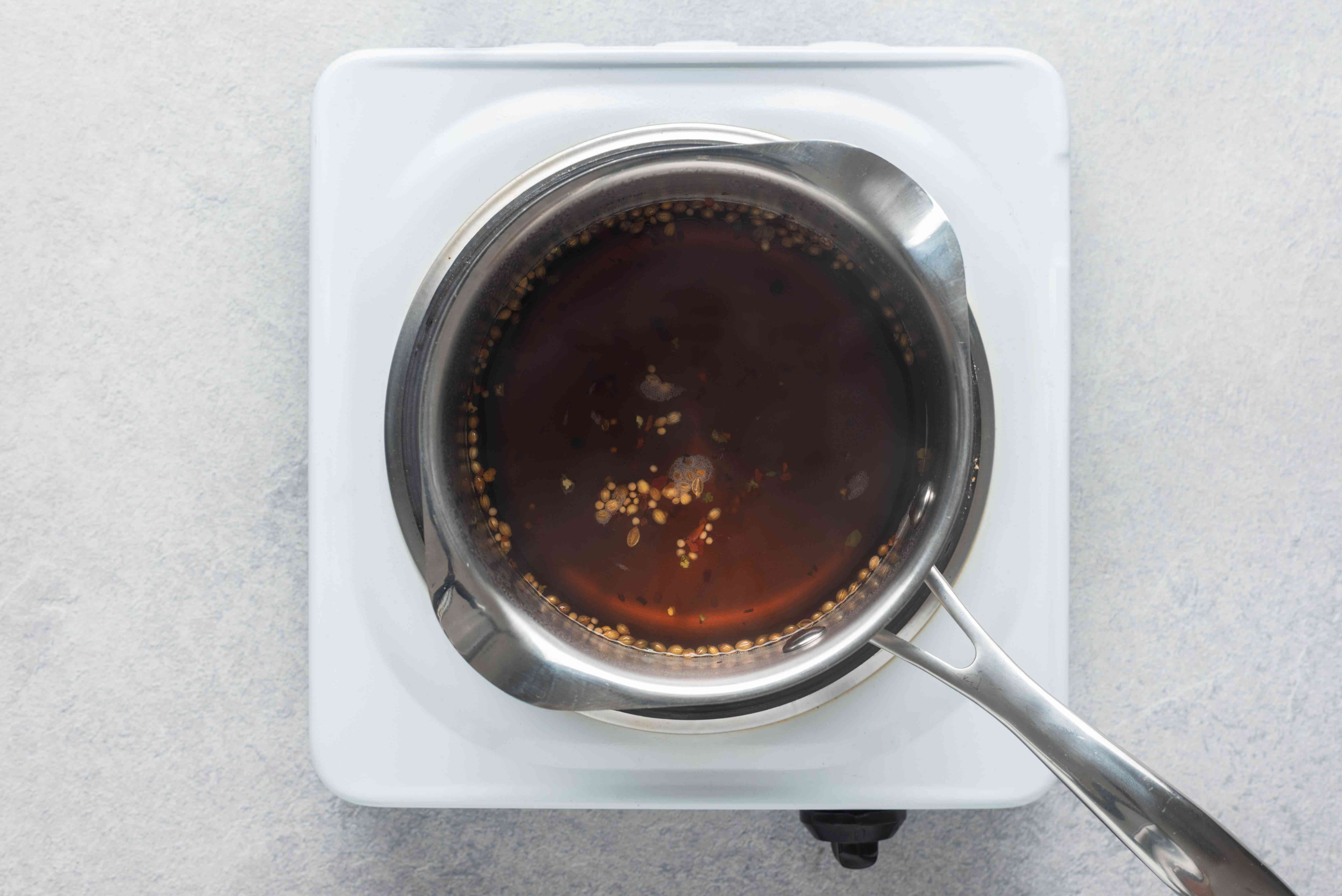 Vinegar and spice mixture cooking in a saucepan