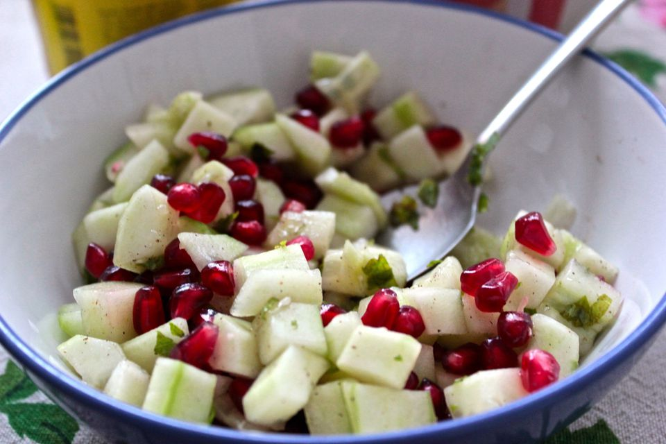 Close-Up Of Sliced Cucumber And Pomegranate In Bowl On Table