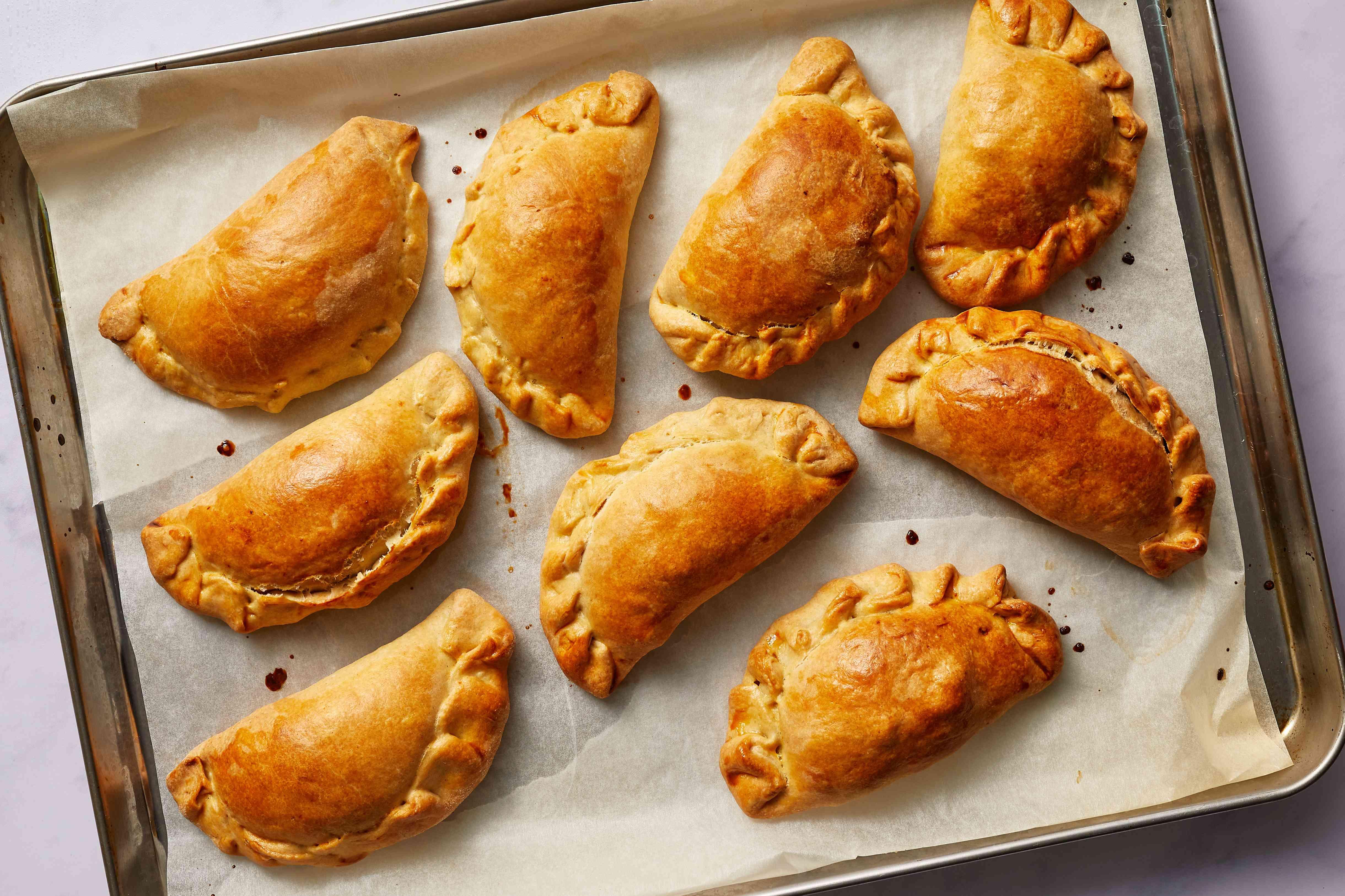 Chilean-Style Empanadas de Pino on a baking sheet