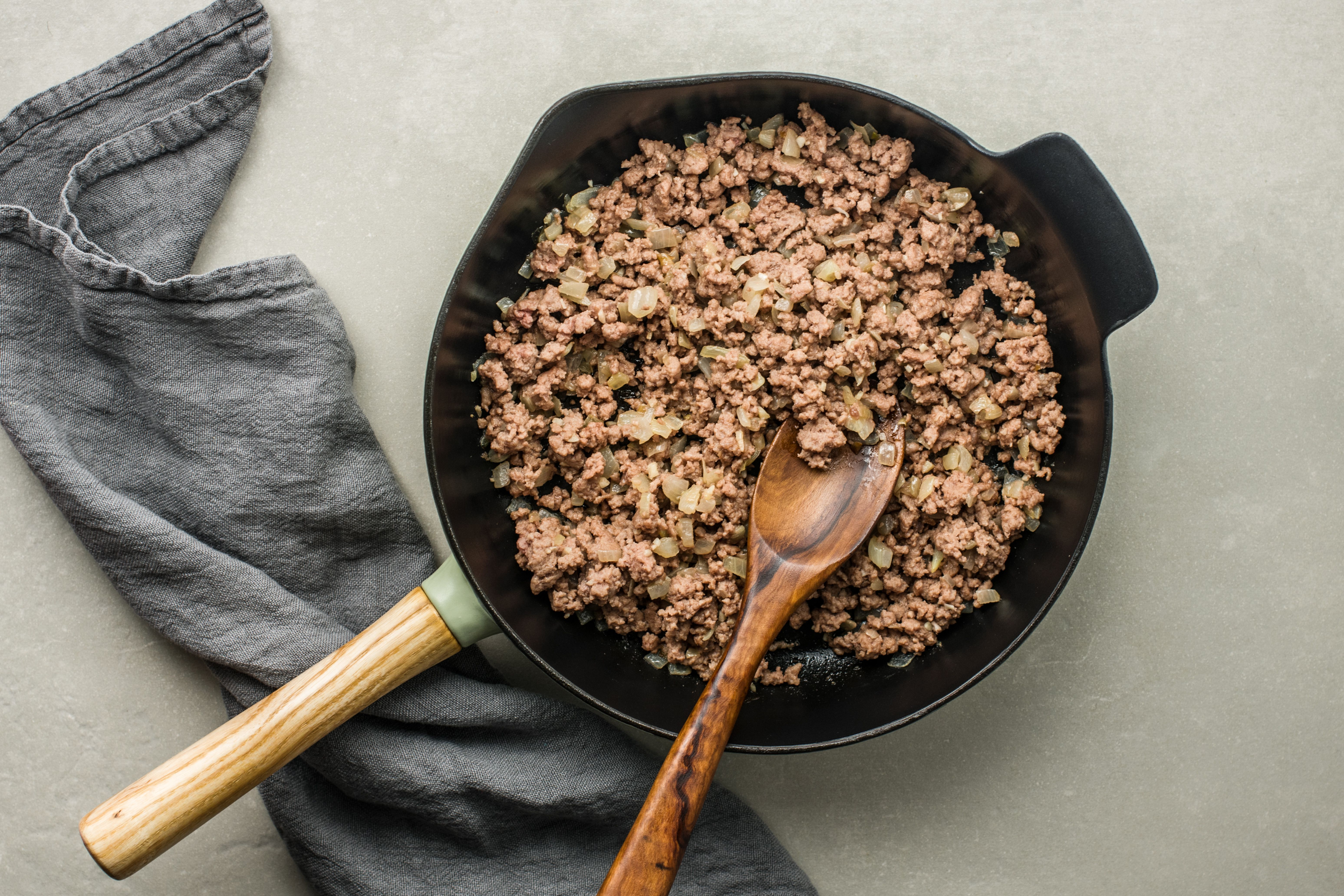 Cooked ground beef in skillet