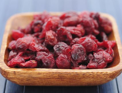 Dried cranberries in a wooden bowl