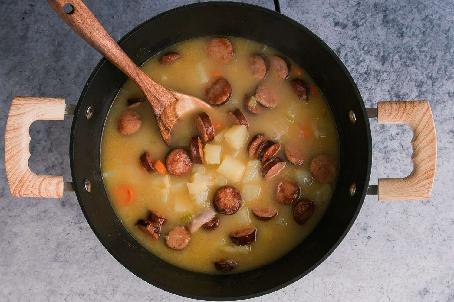 Add the sausage mixture to the simmering stew