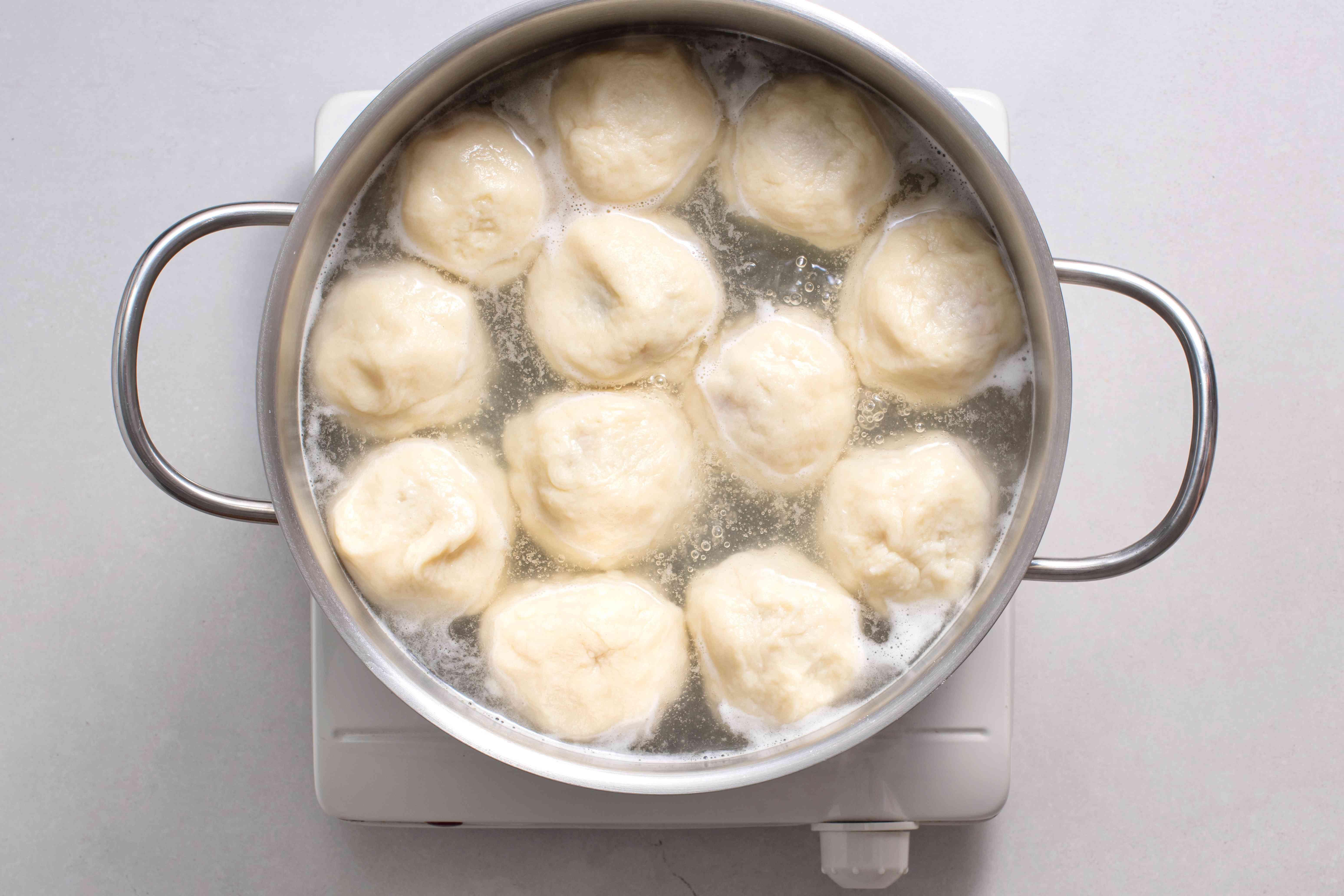 dumplings boiling in a pot
