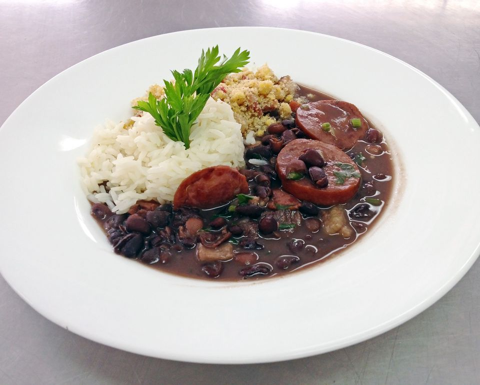 Traditional feijoada with rice and other sides