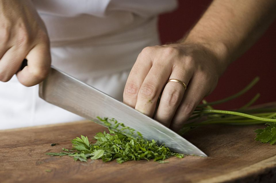 Chef chopping parsley