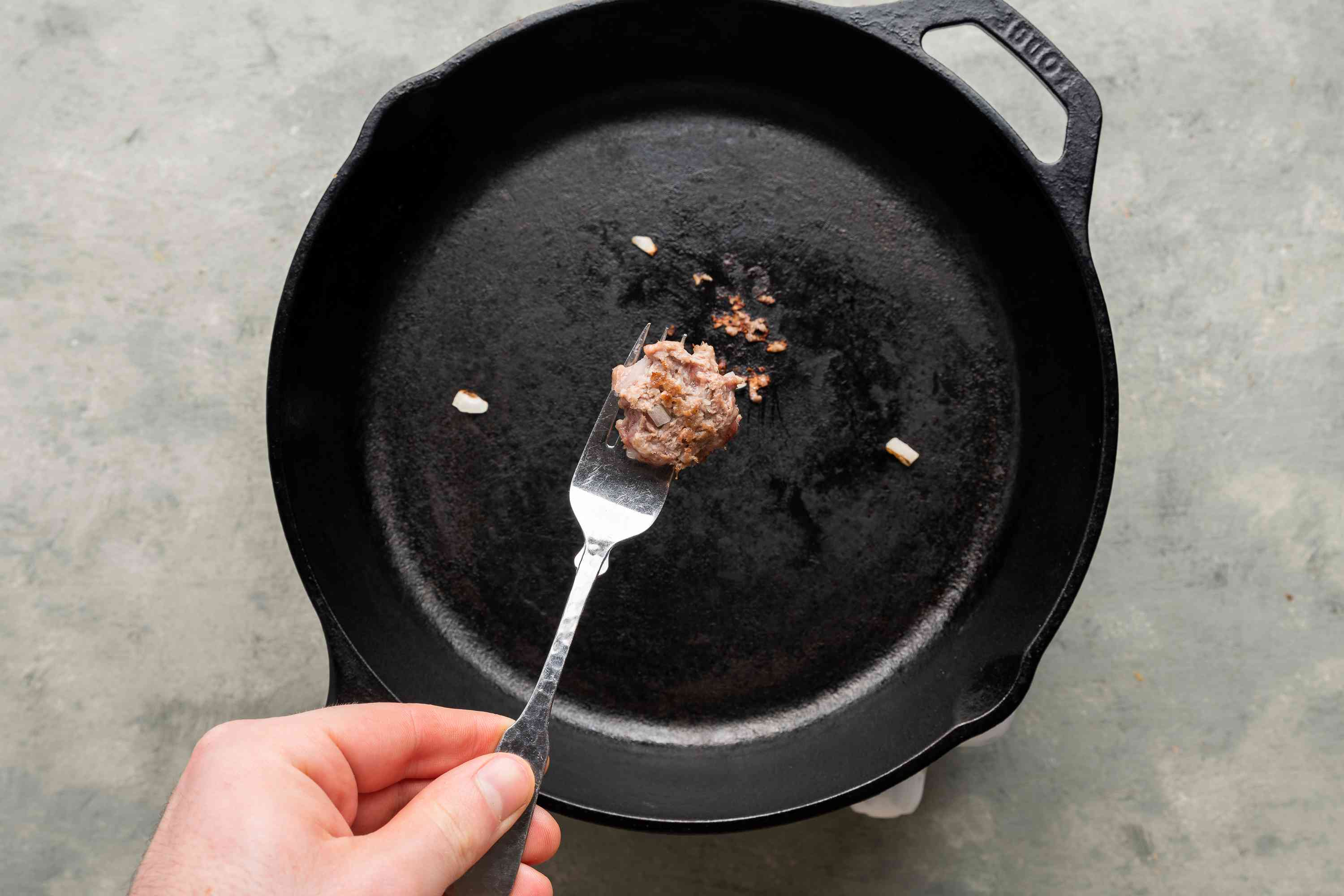 small piece of cooked meat, fried to test the seasoning