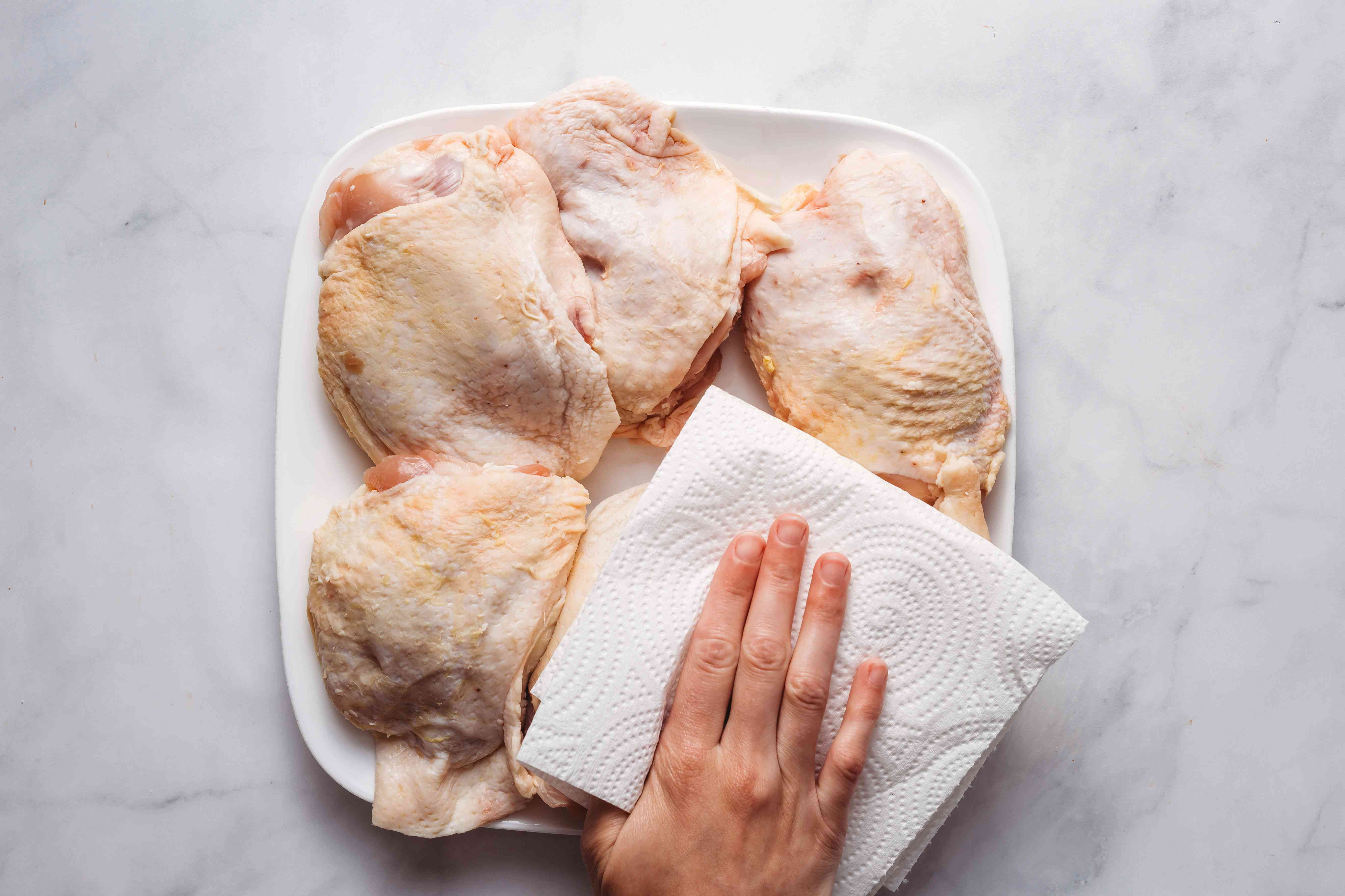 Pat the chicken thighs dry with a paper towel