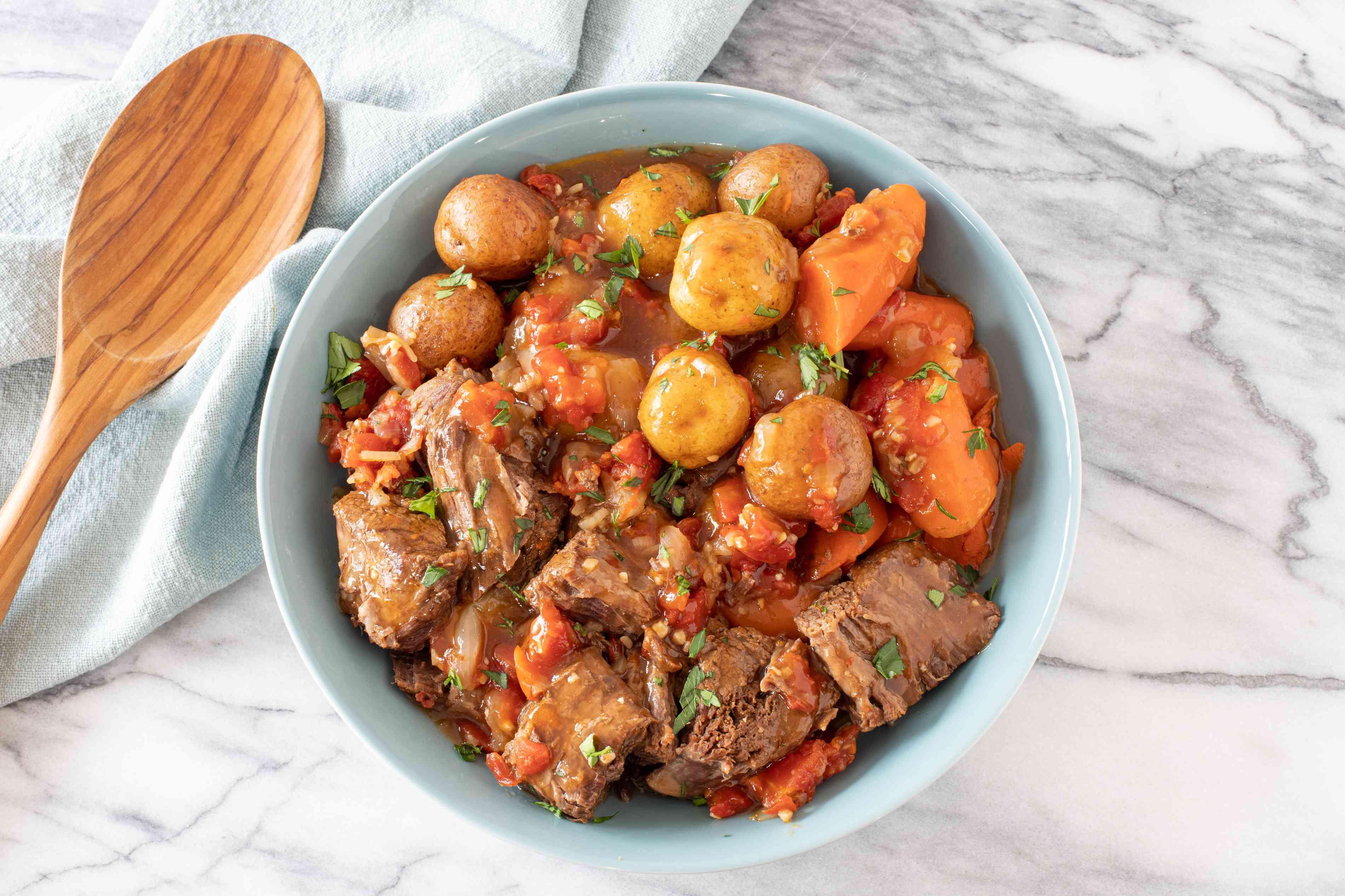 Slow cooker pot roast with potatoes, Italian-style.