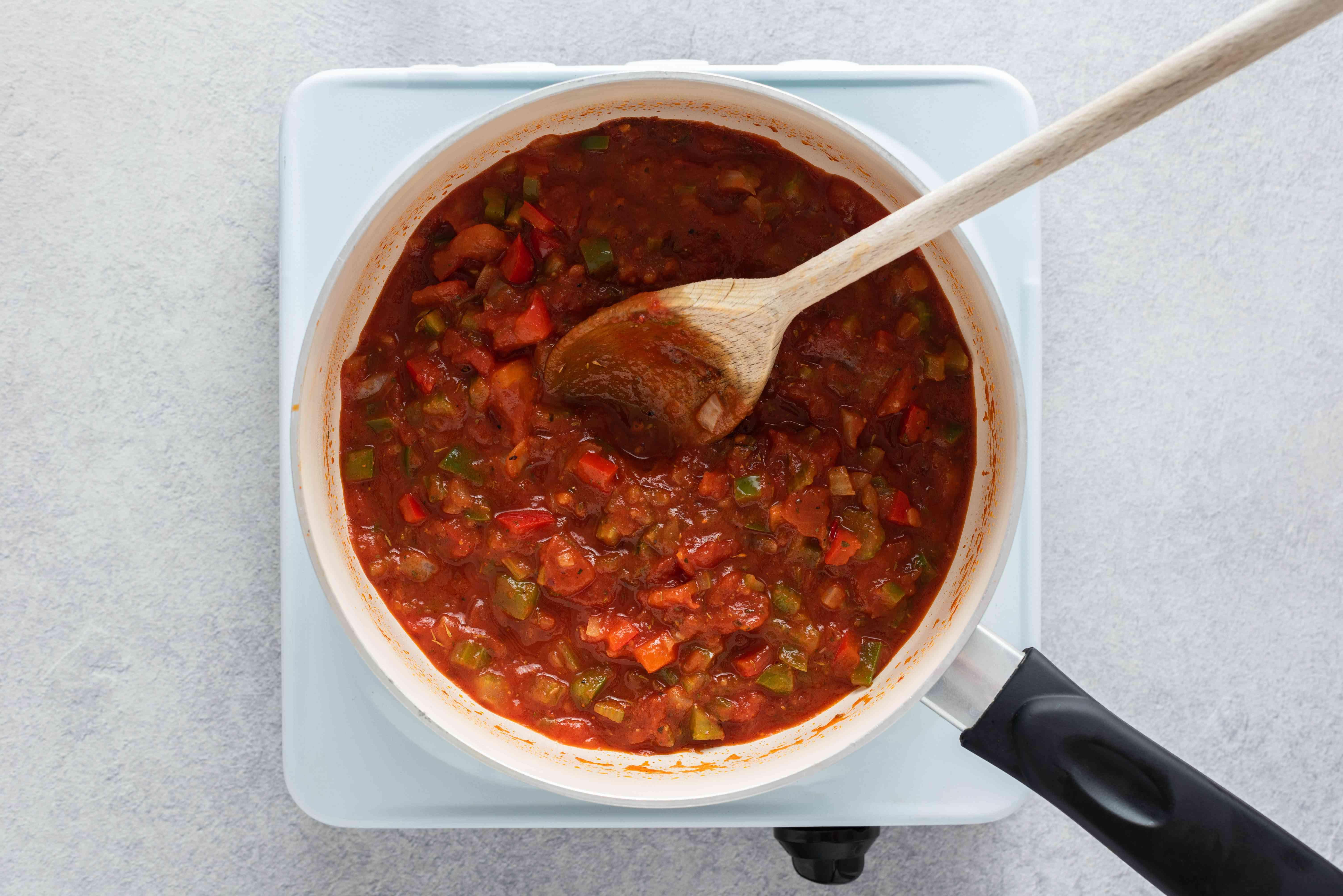vegetables and seasoning mixture in a pan