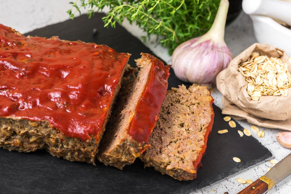 Slices of savory meatloaf with oatmeal and a ketchup topping