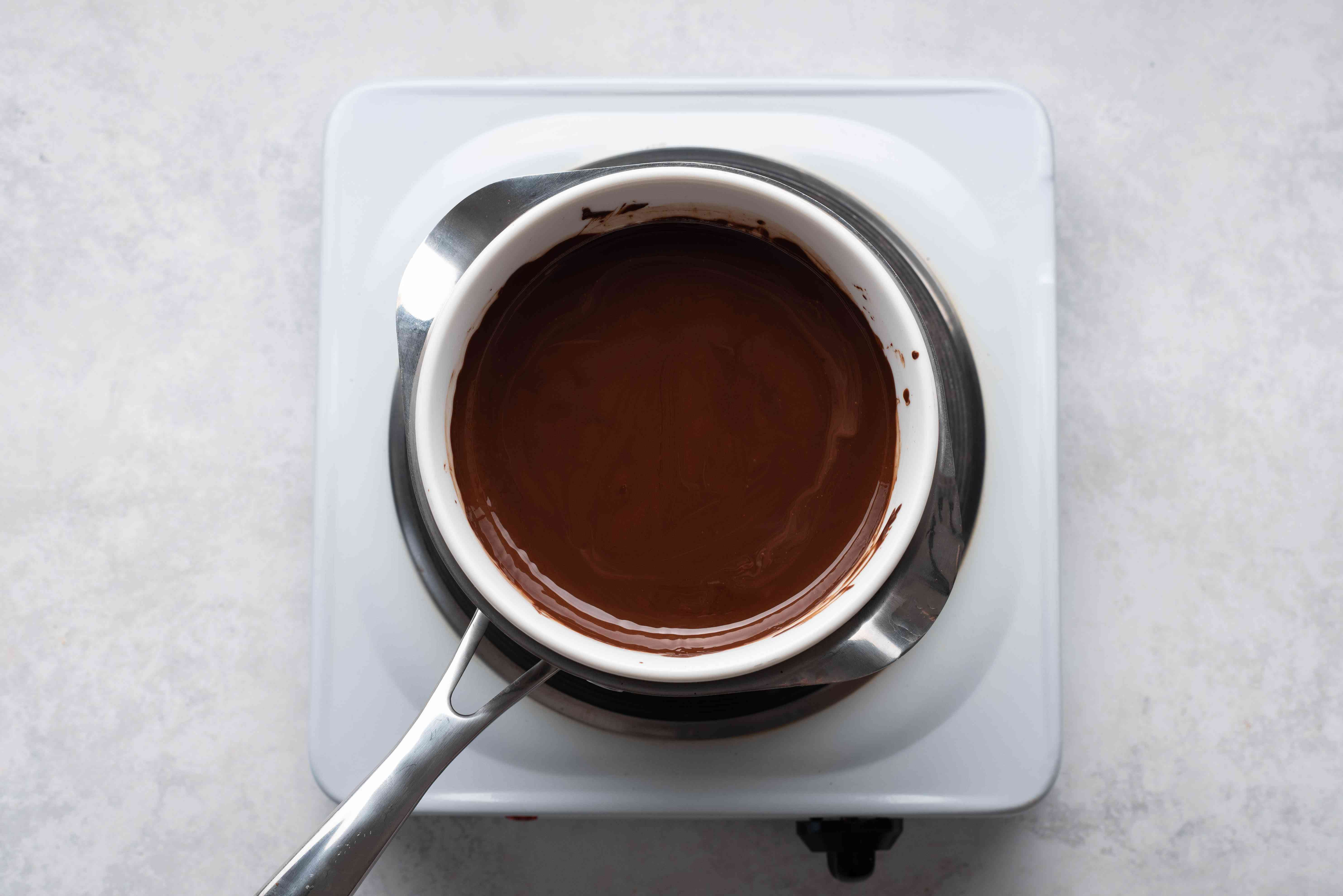 melted chocolate over a double boiler