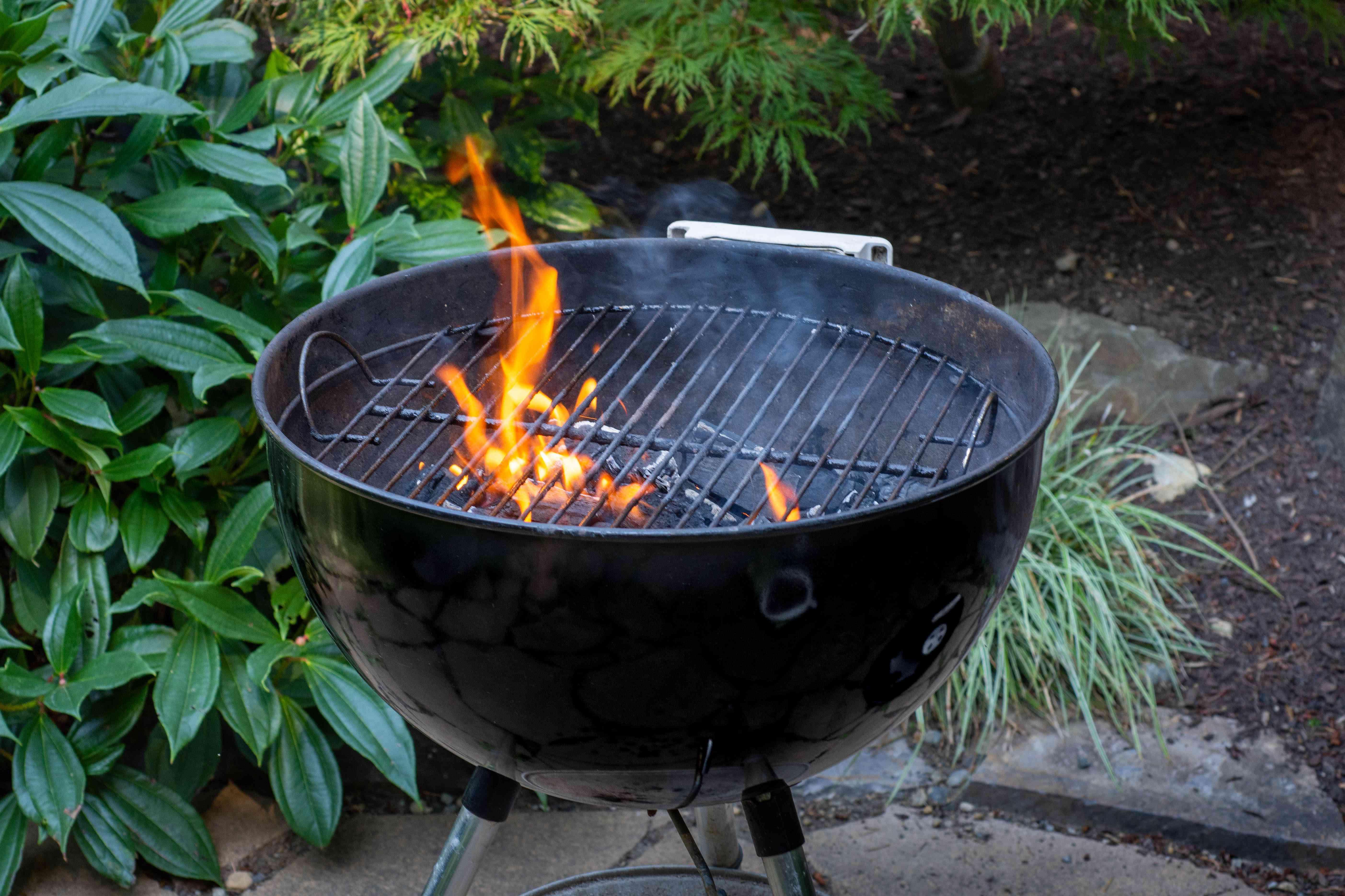 black grill outside, fire