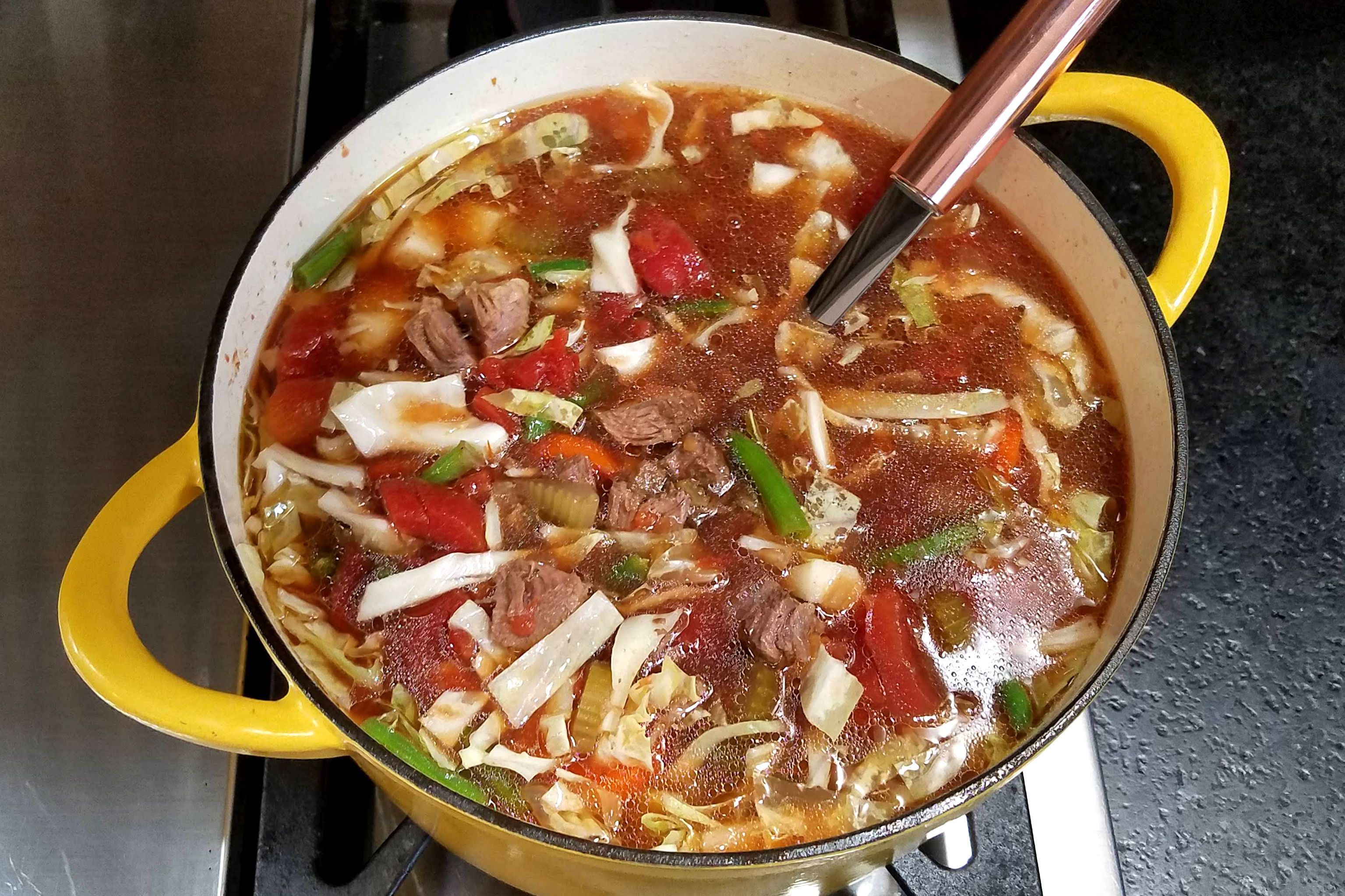 Vegetable beef soup in a pot
