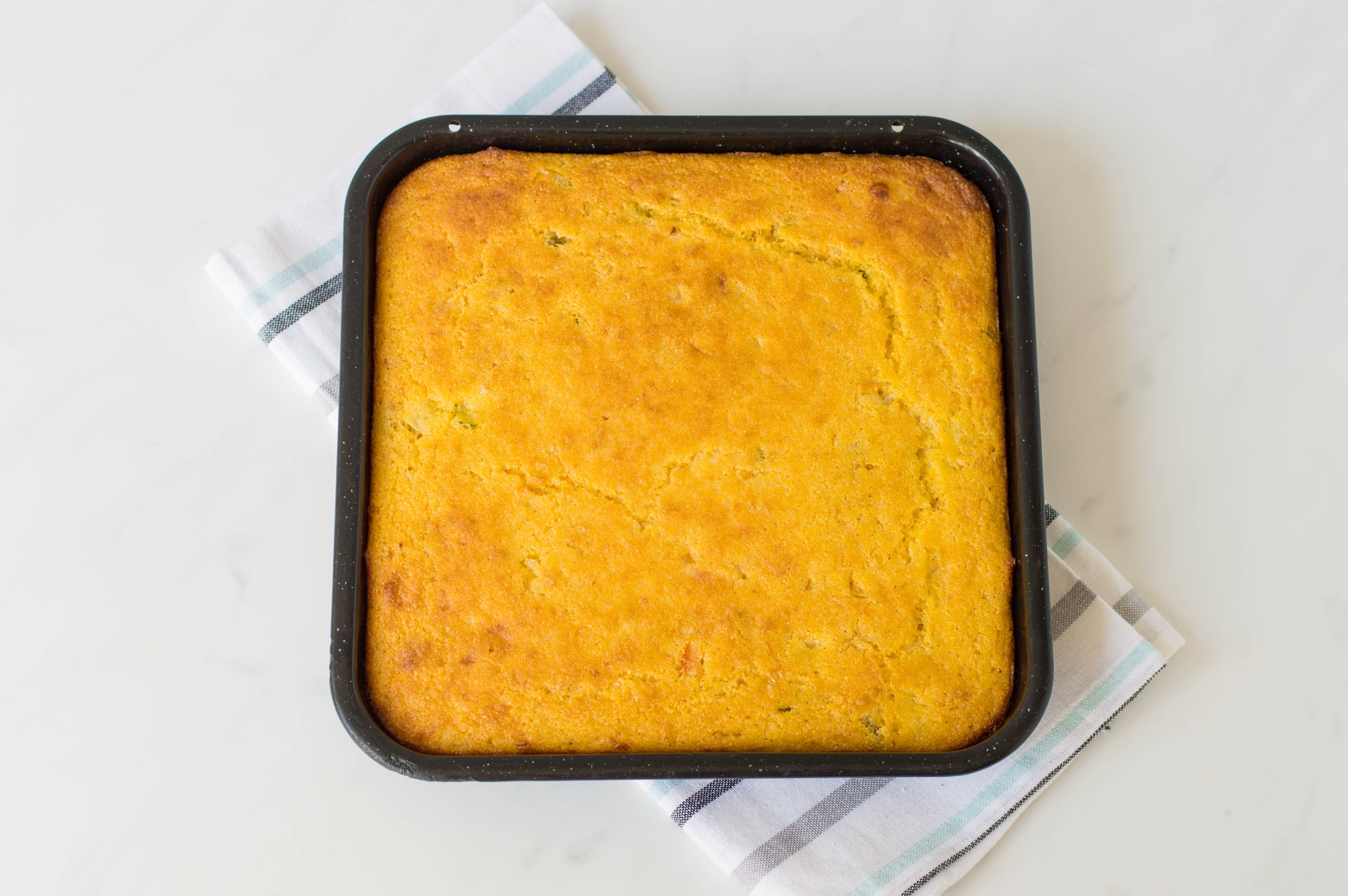 Easy Mexican cornbread baked in a square pan
