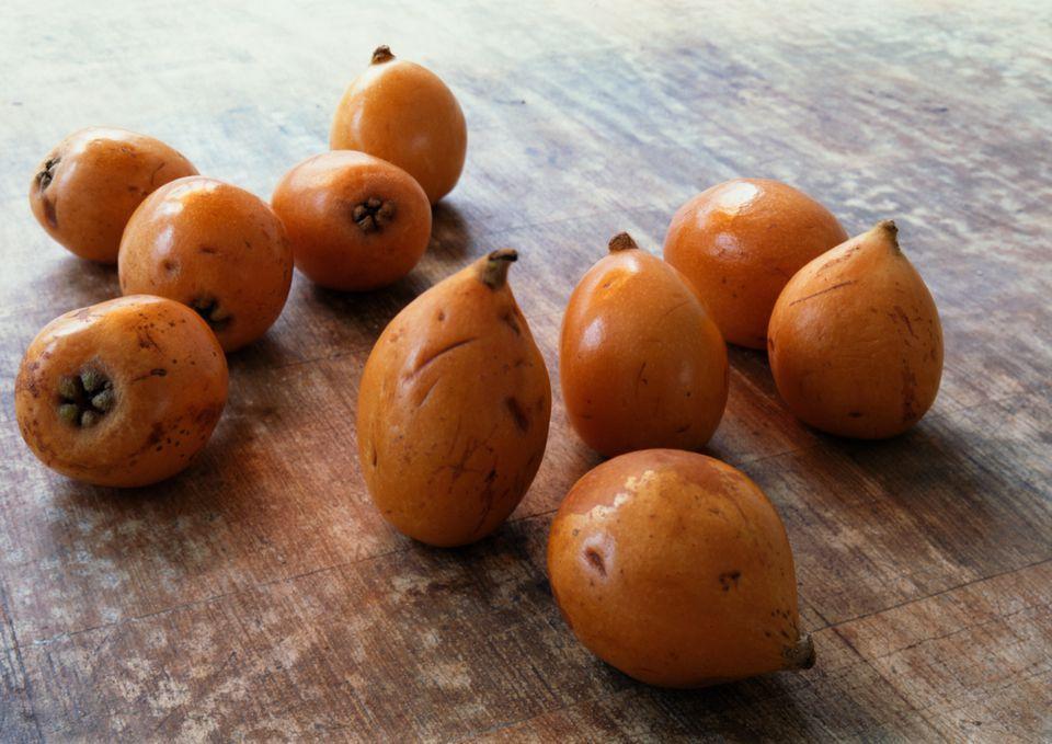 Medlars, a pome varietal, on a wooden table