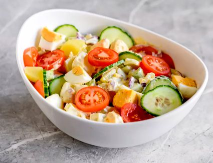 Potato salad with vegetables and eggs.