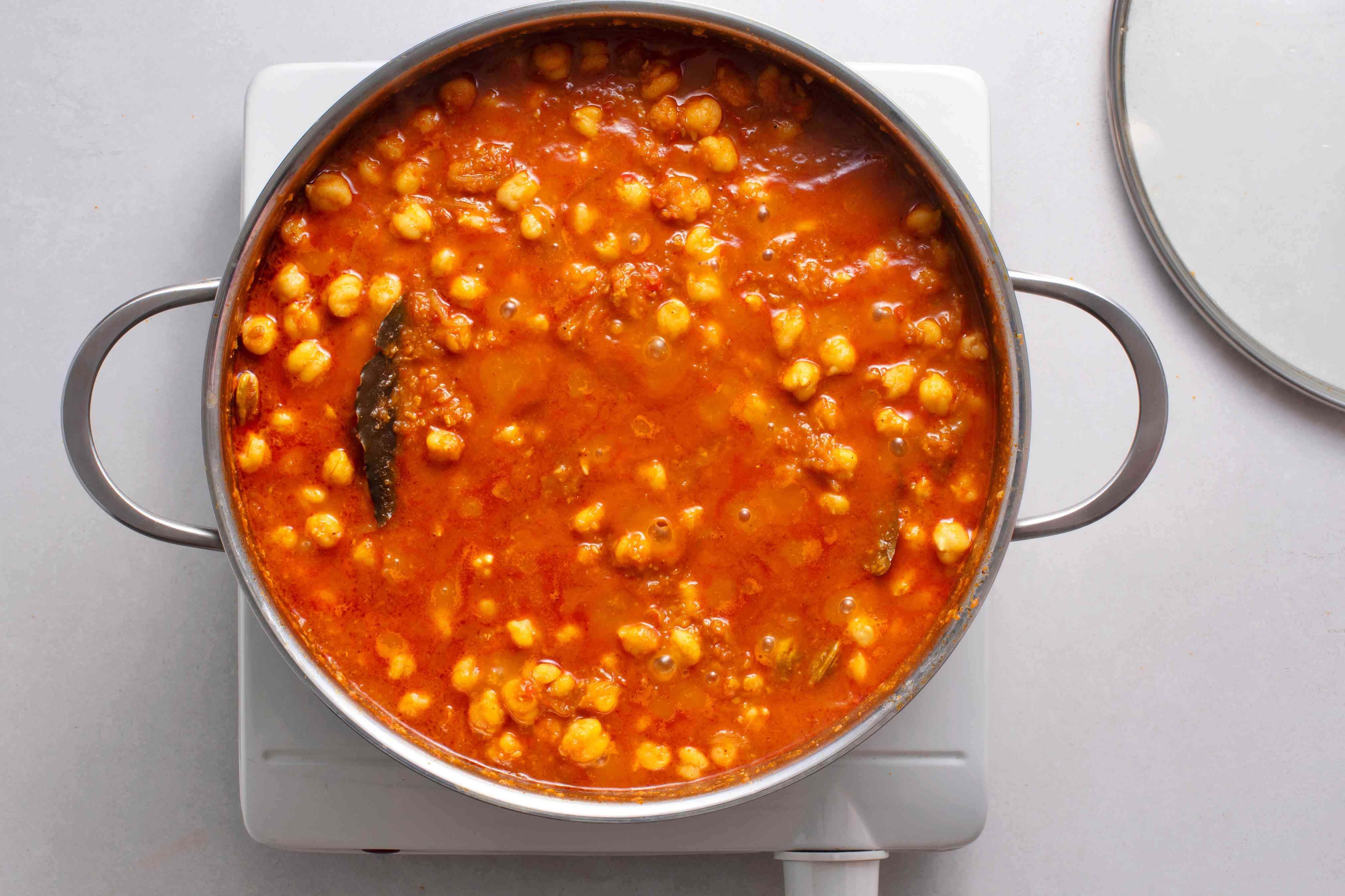 Simmer and cook chickpeas and masala