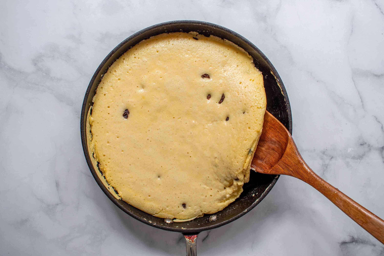Austrian pancake cooking in a skillet