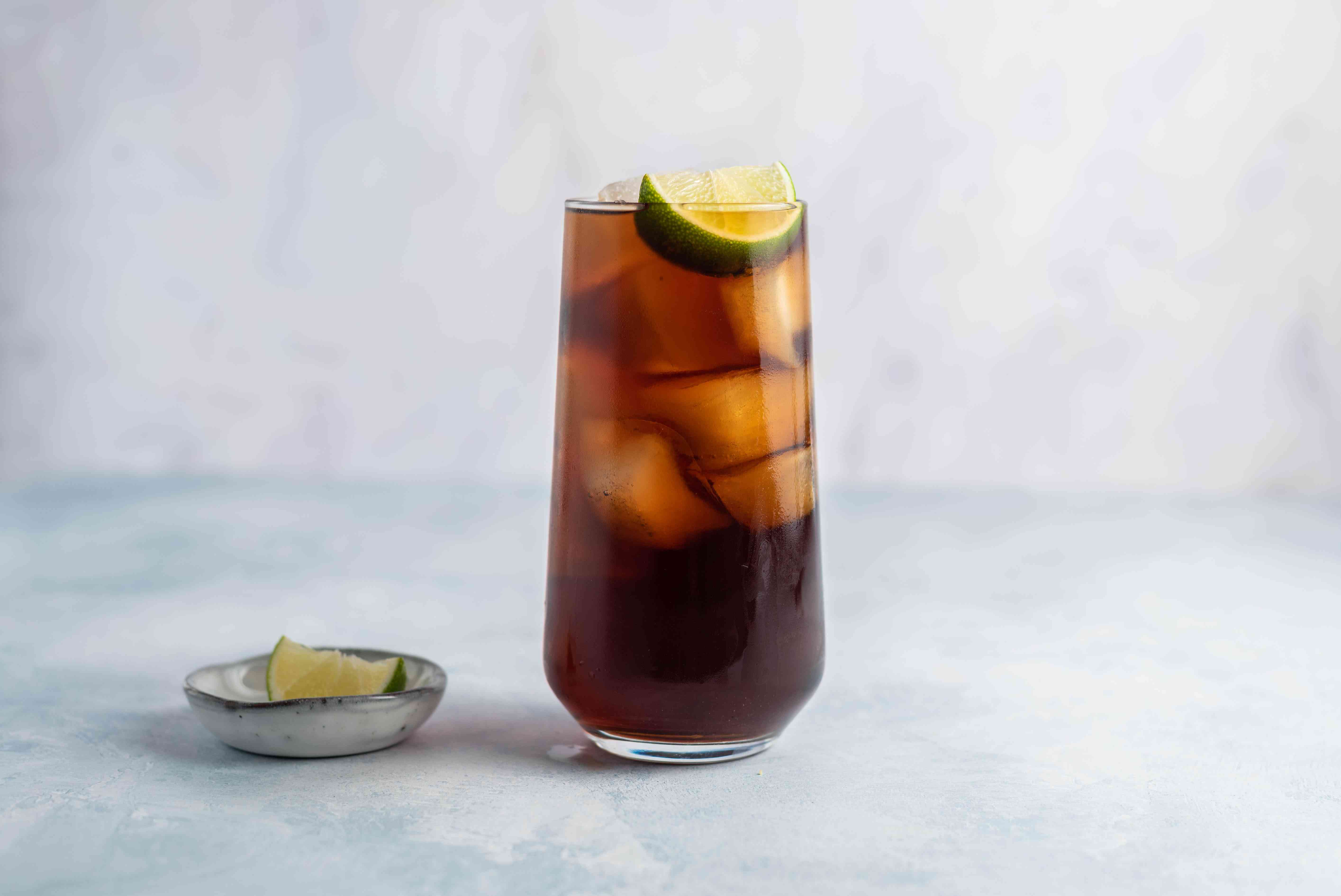 Rum and Coke garnished with a lime wedge