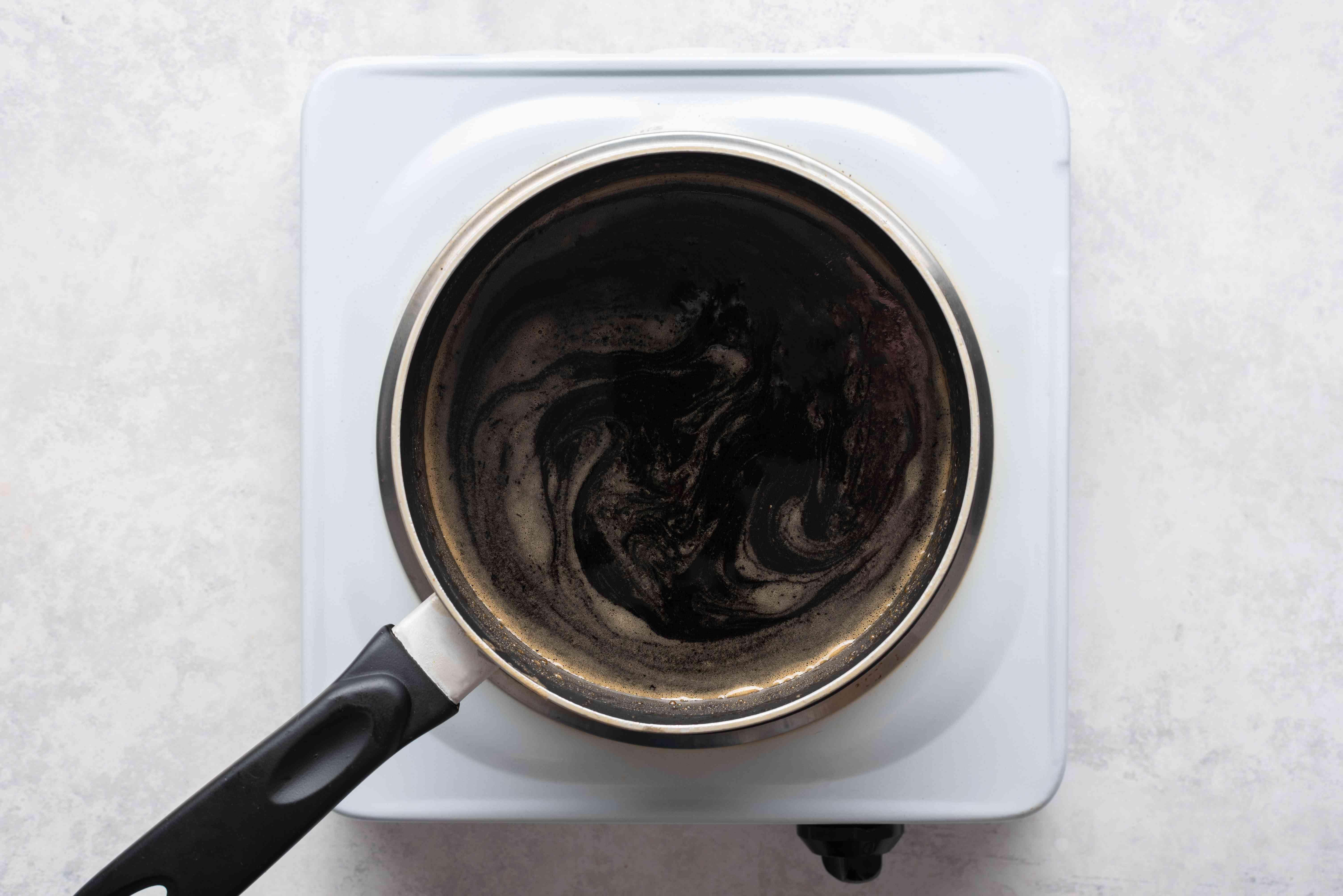 Place cider vinegar, brown sugar, white sugar, and lemon juice in a saucepan