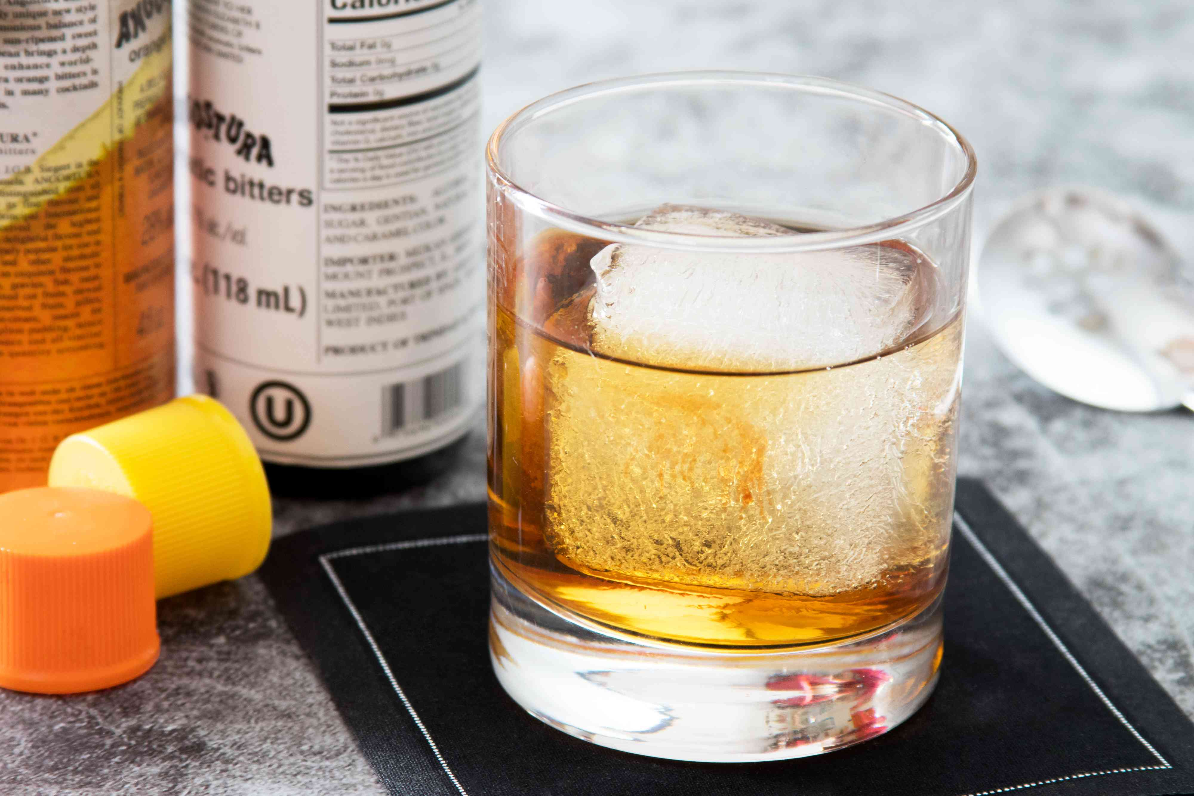 Rum Old-Fashioned Cocktail with bitters added