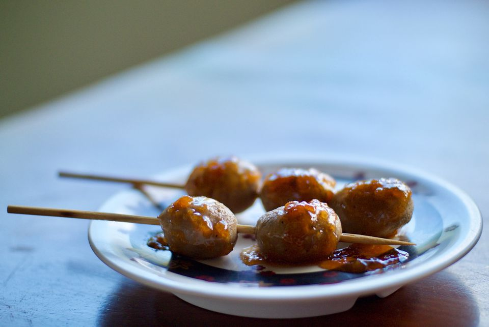 Close-up of meatballs on toothpicks on a table