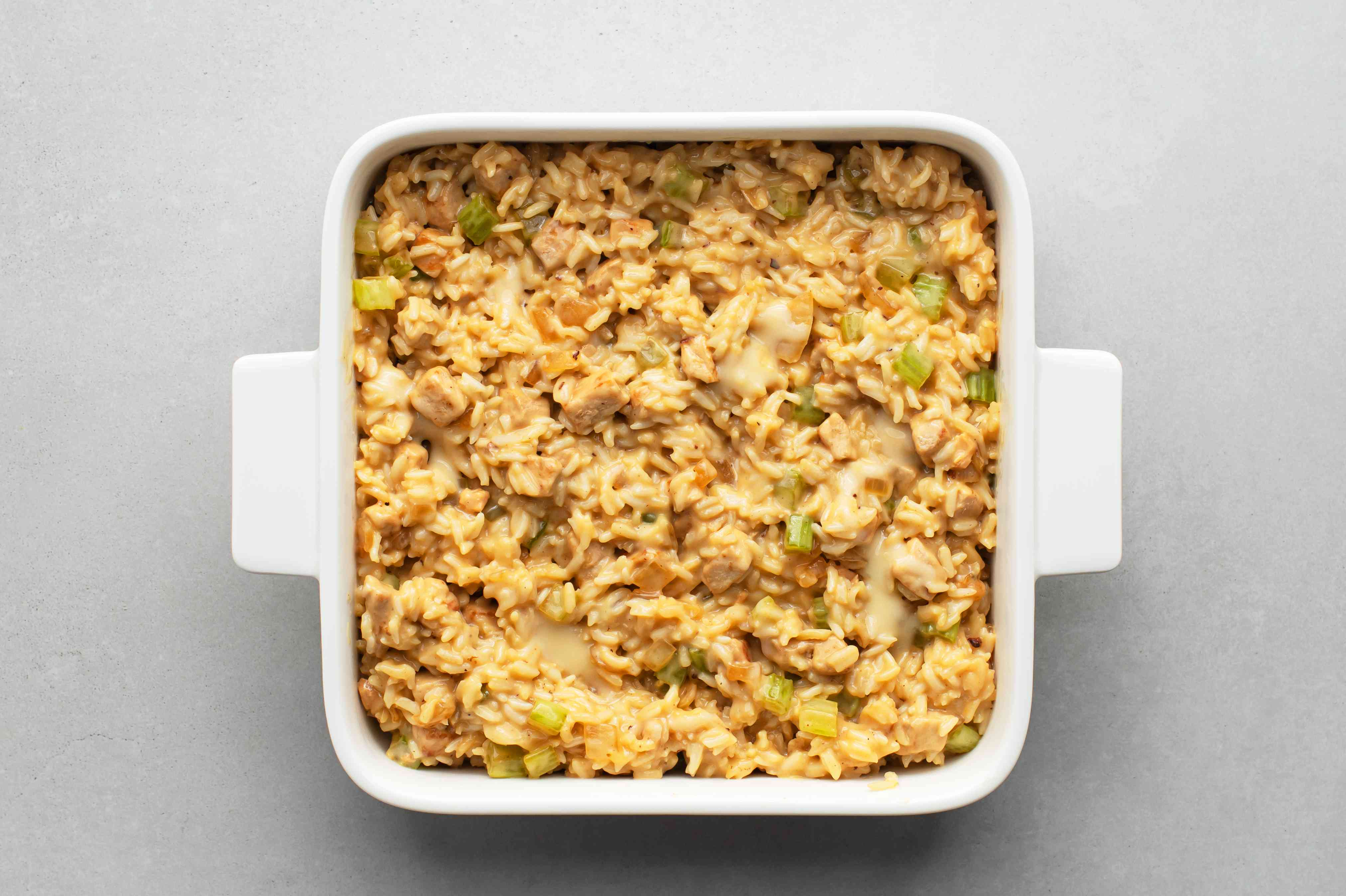 Spoon the pork, rice, and vegetable mixture into the prepared casserole dish