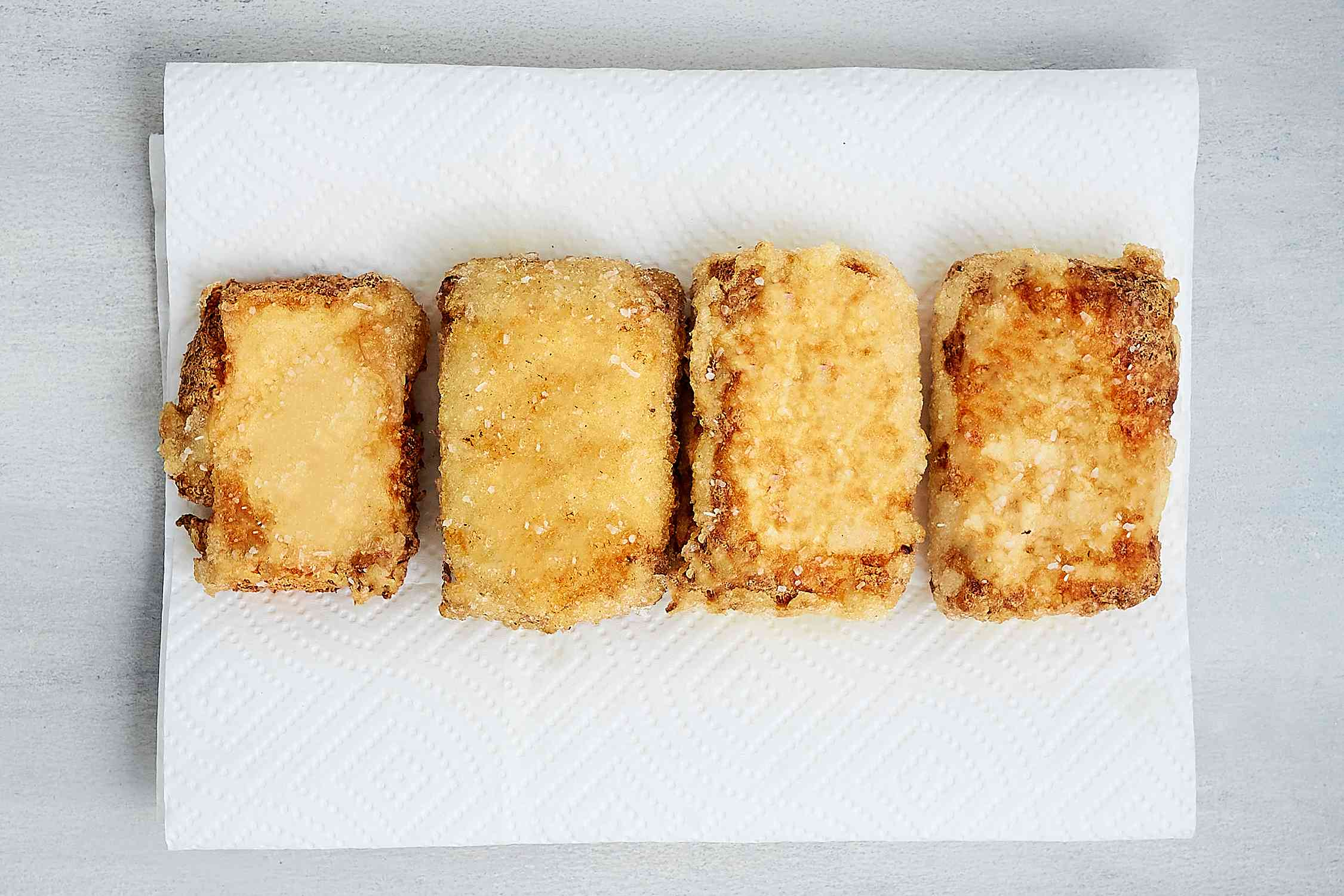 fried tofu on top of paper towels