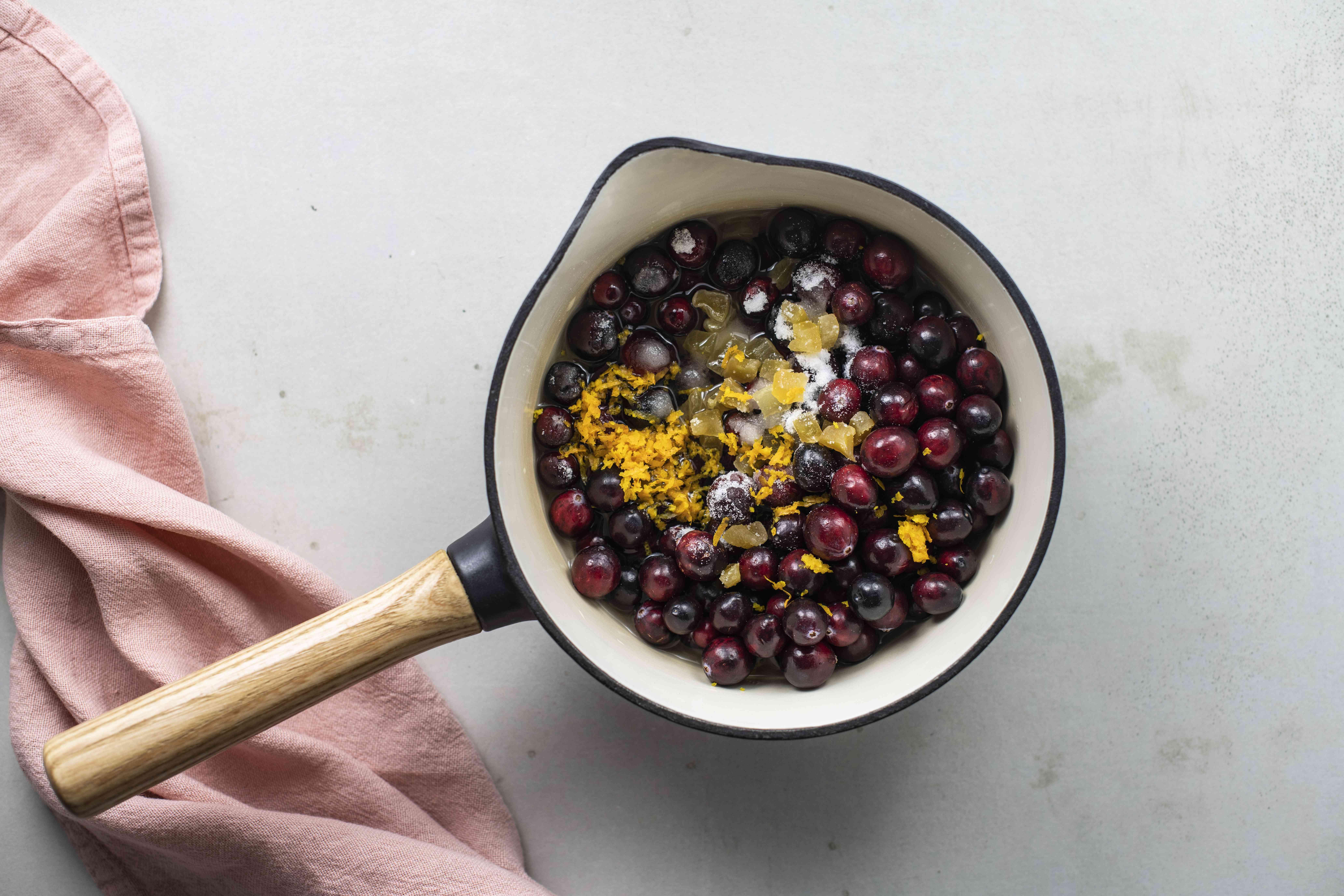 Combine cranberries and orange
