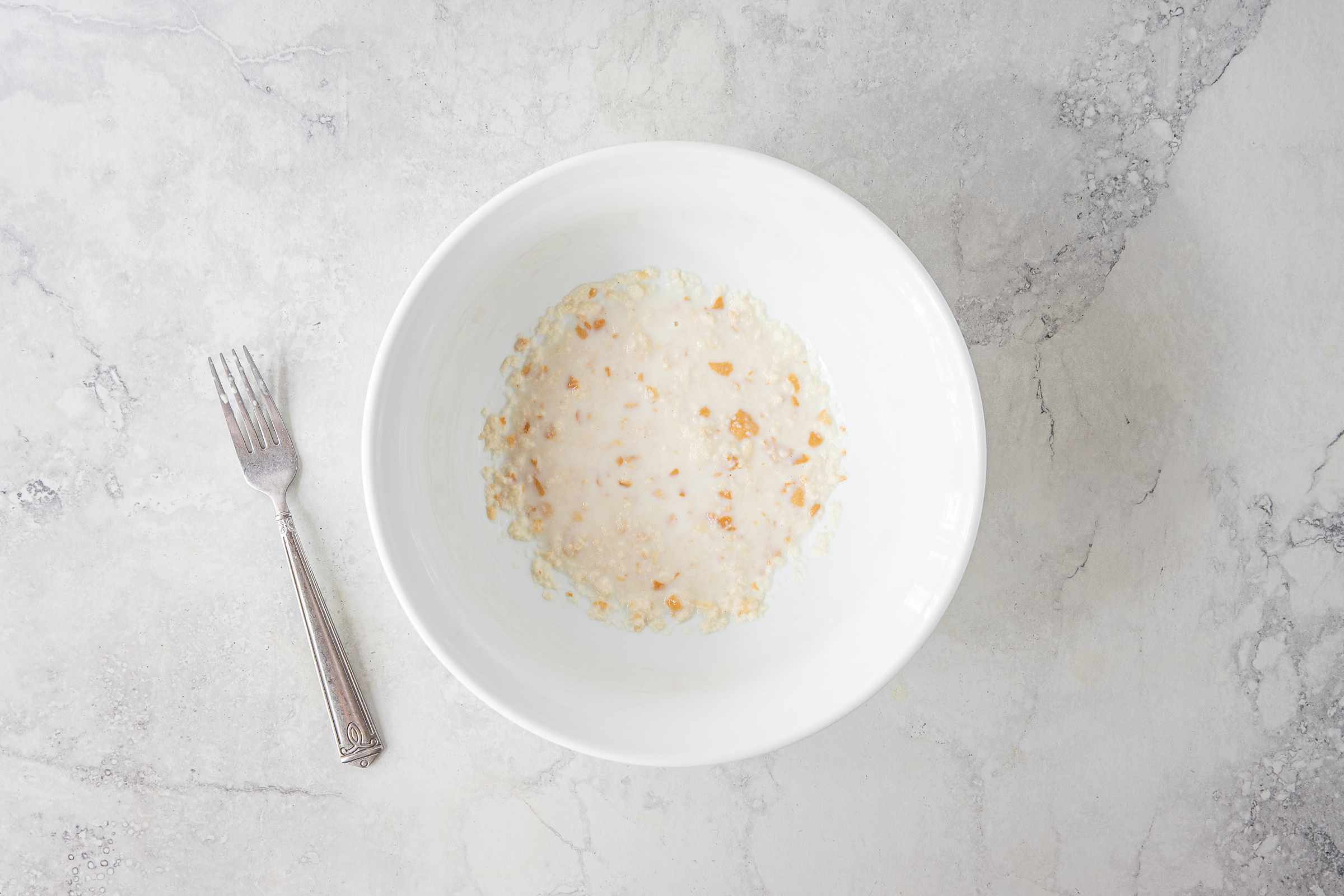 breadcrumbs and milk in a large bowl