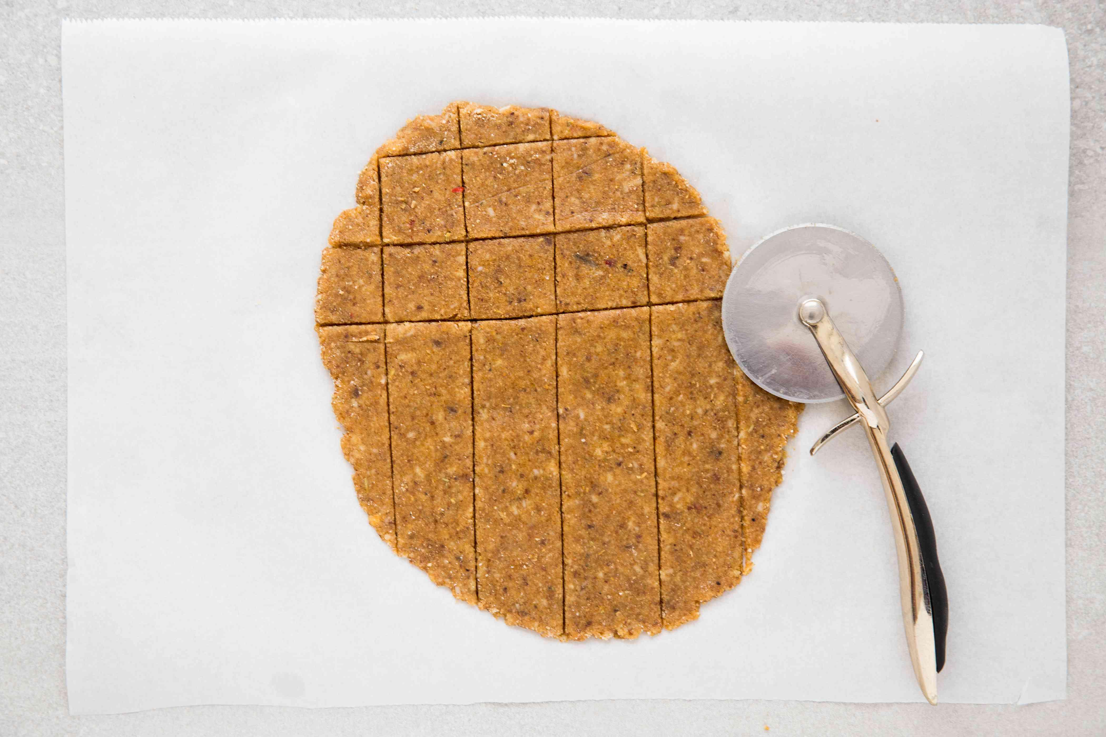 flax cracker dough cut with a roller