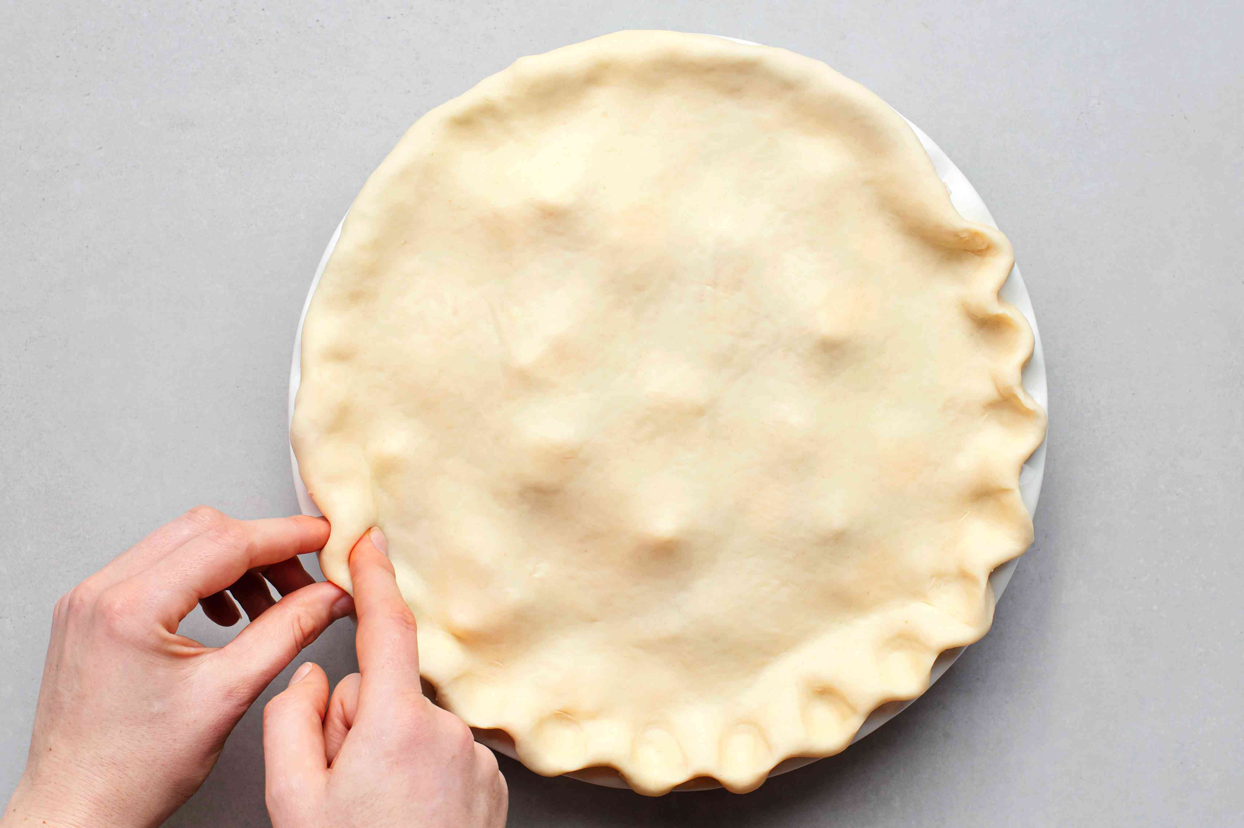 Place the second crust on top and crimp the edges