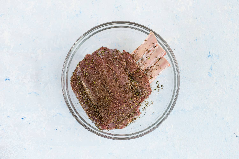 Raw, seasoned prime rib in a bowl