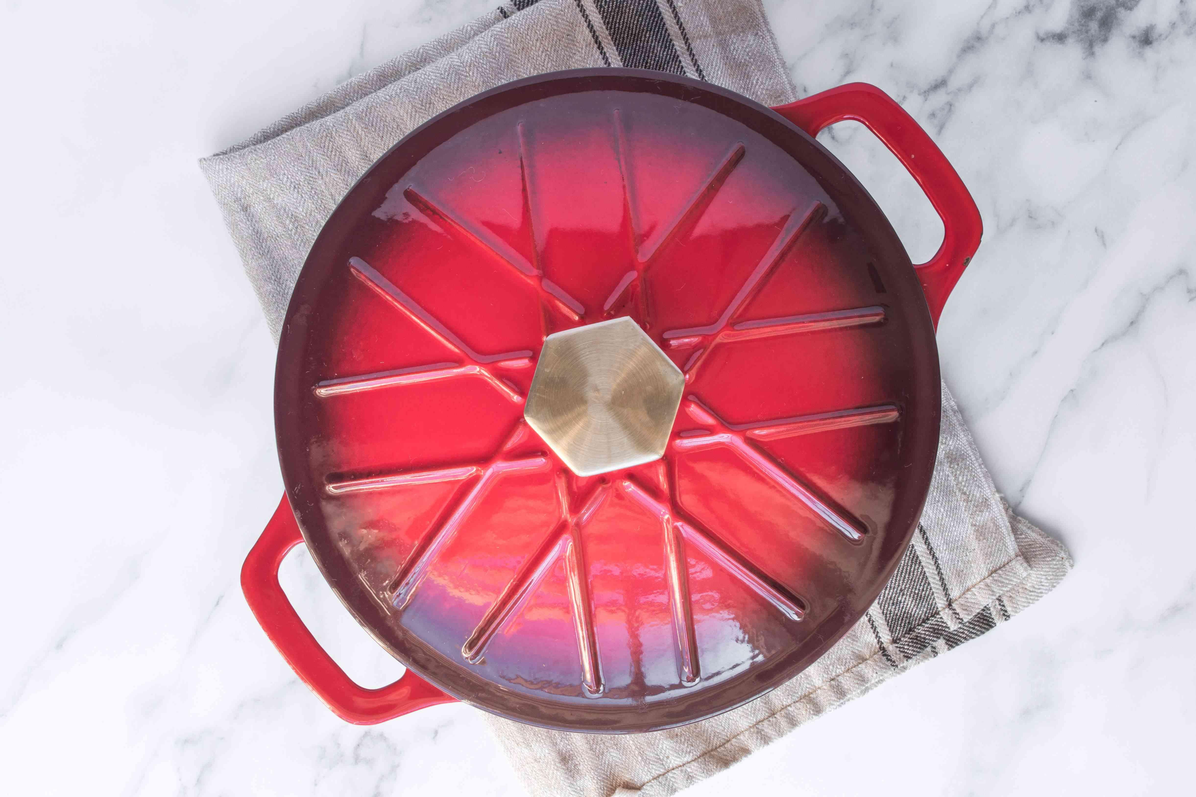 Lid covering saucepan.
