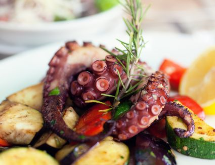 Grilled octopus with vegetables and herbs