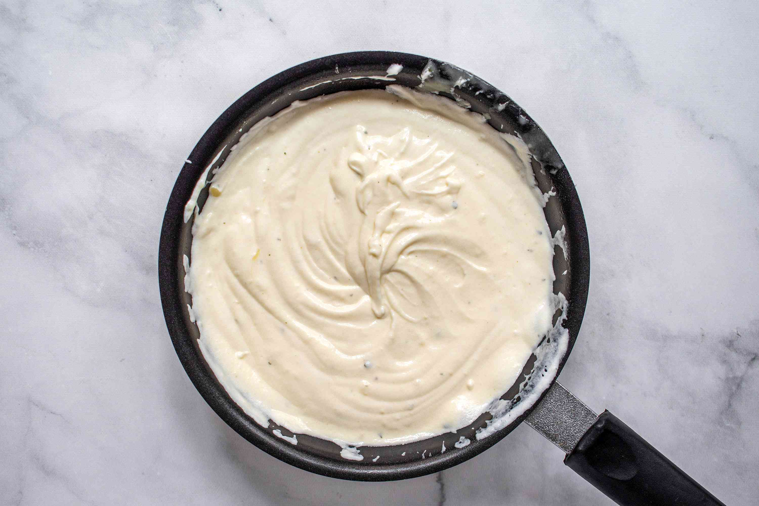 add tempered sour cream back into the sauce