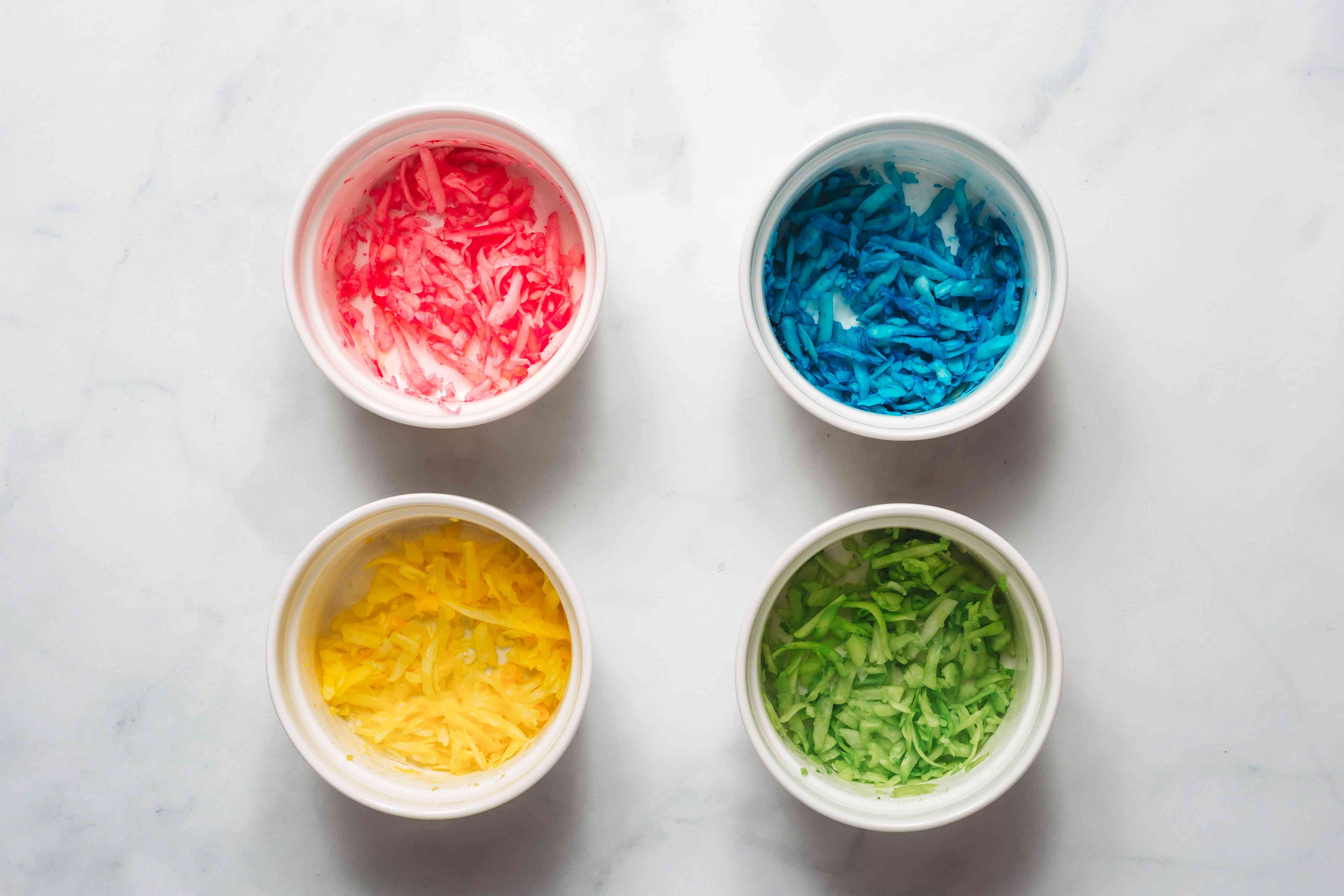 pink, blue, yellow and green died cheese in bowls