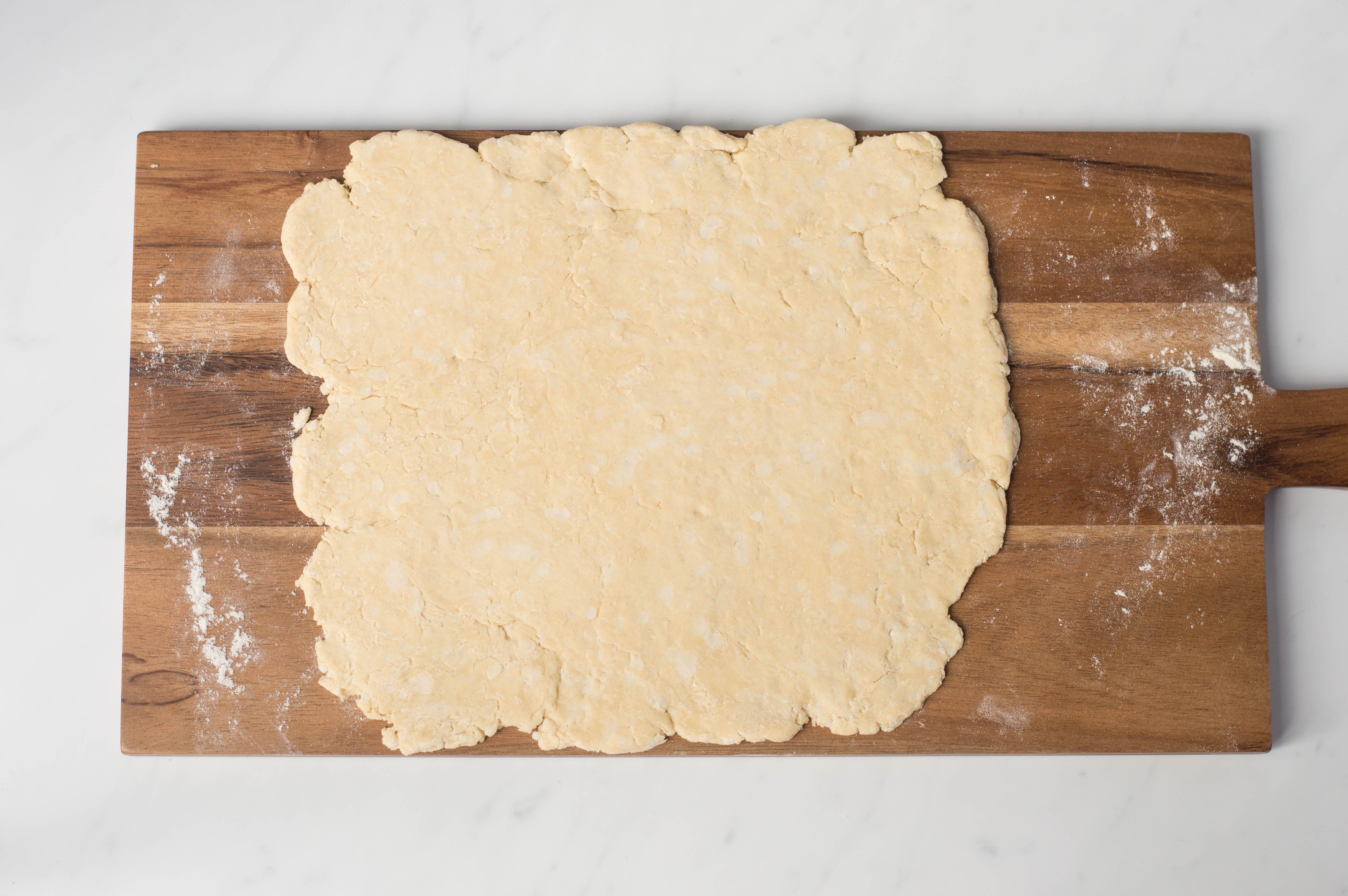 Dough on lightly floured wooden board
