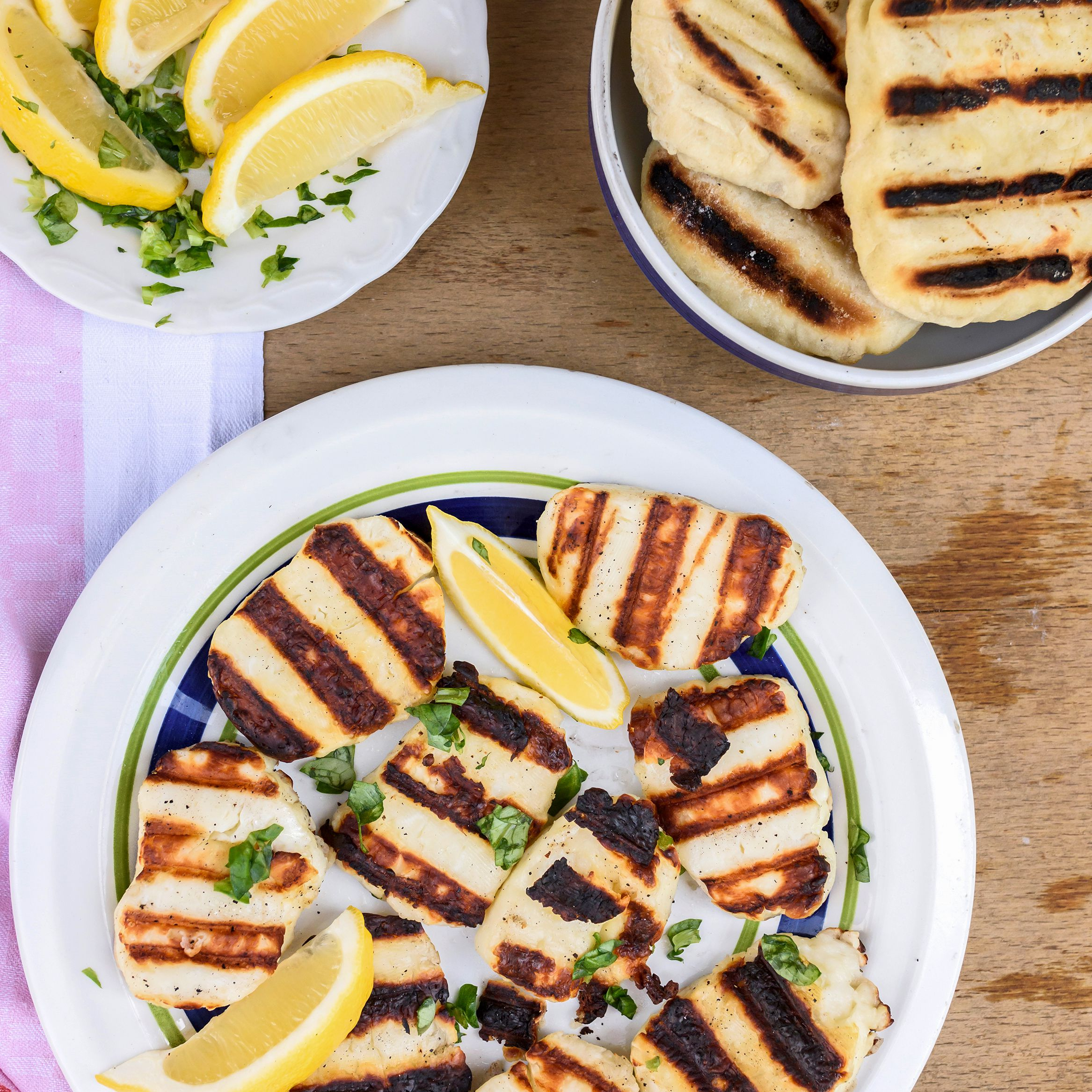 Grilled halloumi cheese and pita bread with lemon wedges