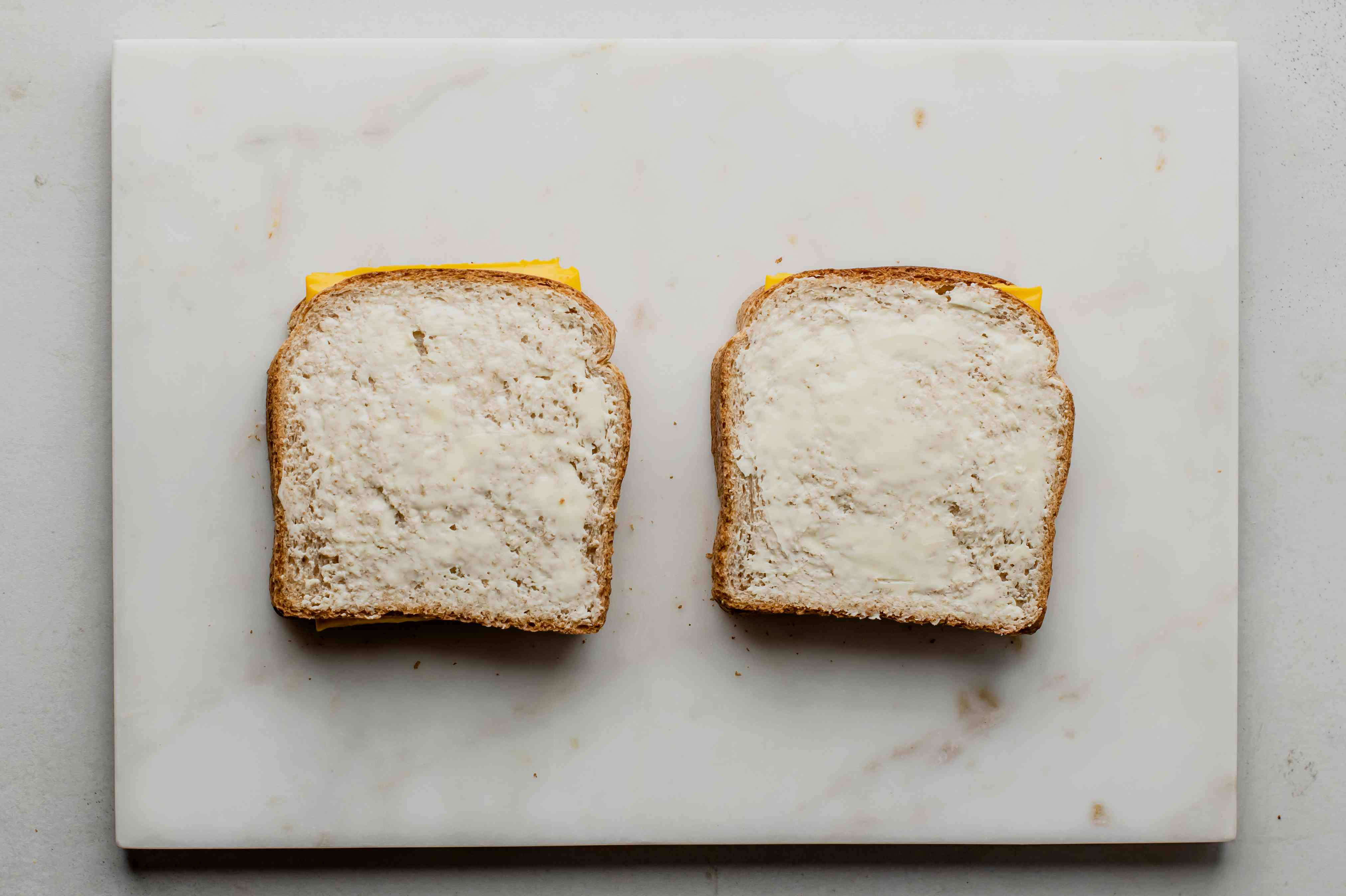 Spread bread with butter