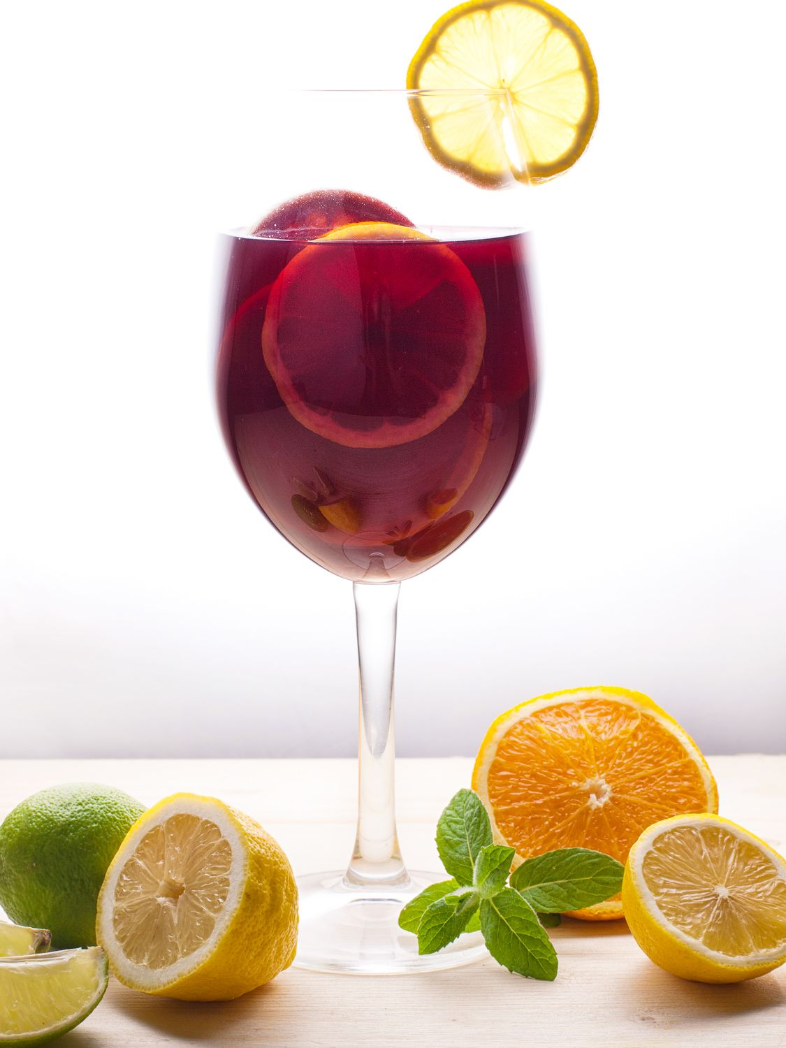Add club soda and garnish glass of sangria with lemon before serving