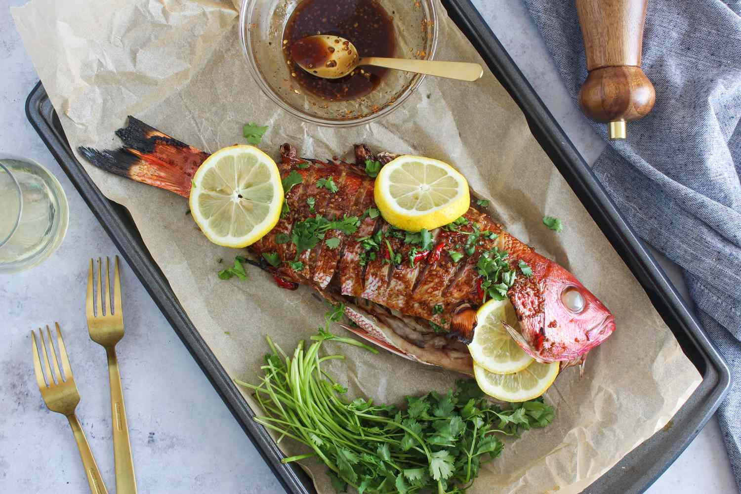 Baked whole fish in garlic-chili sauce