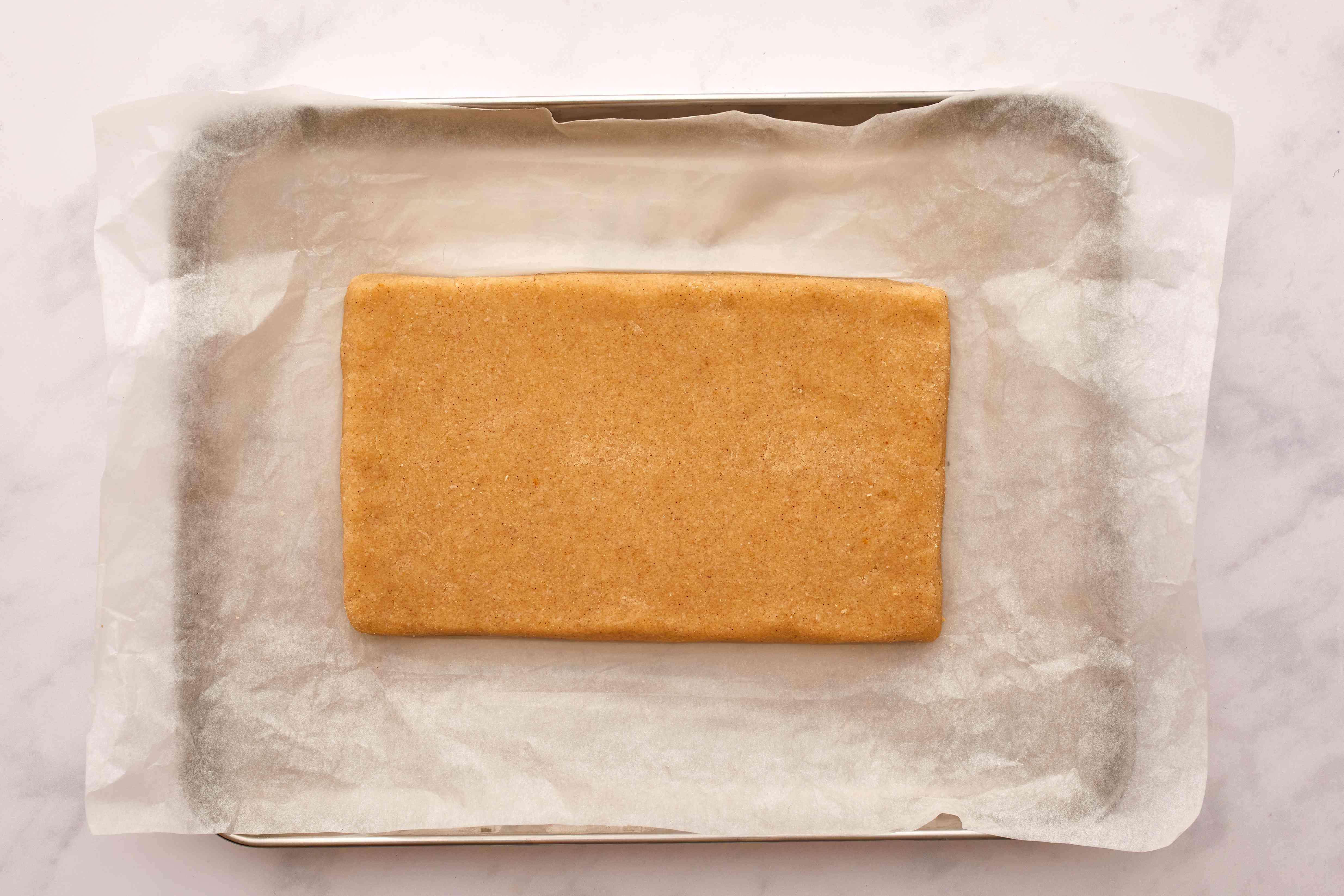 keto ladyfingers dough in rectangle on sheet pan ready to bake
