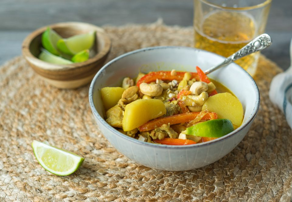 Serve Thai Massaman Chicken Curry with garnish and rice