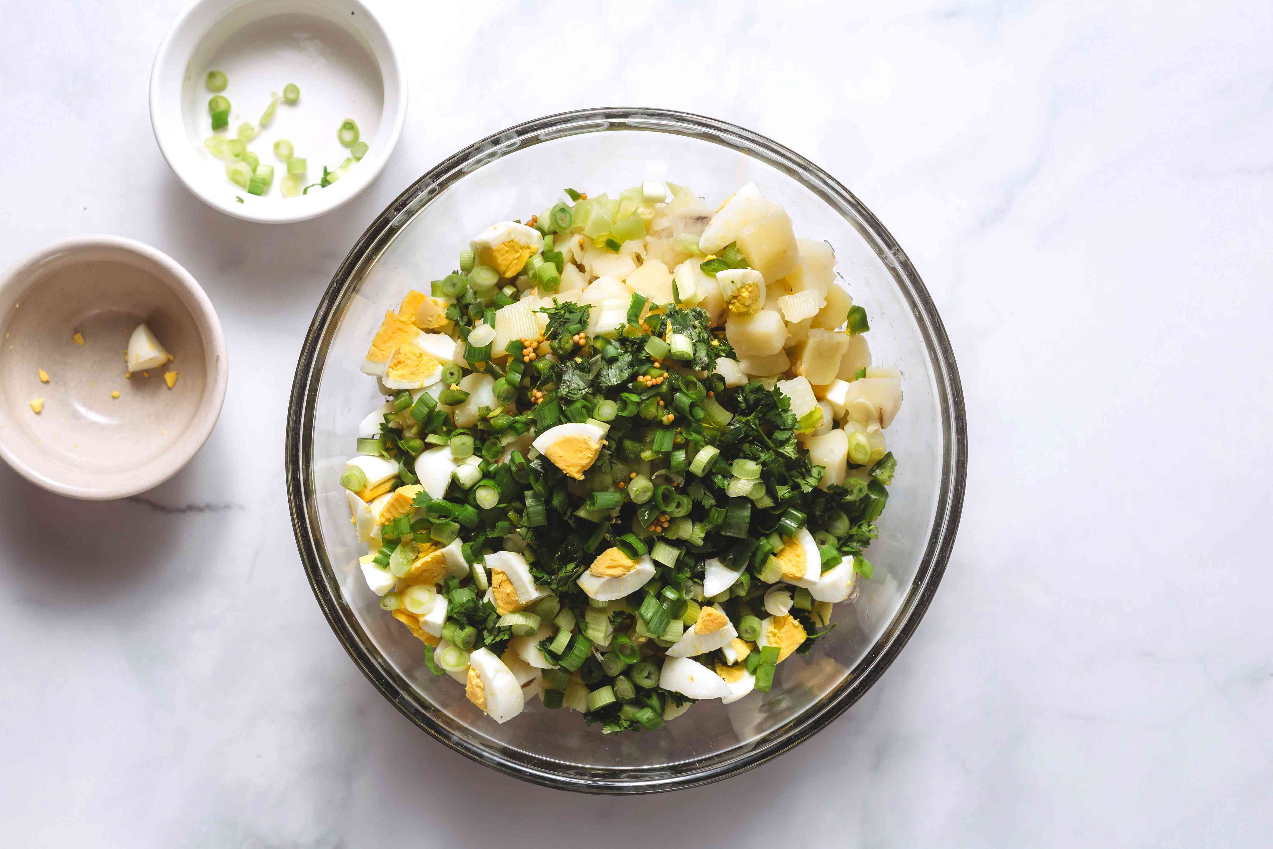 celery, pickled jalapeños, cilantro, egg, and green onions in a bowl