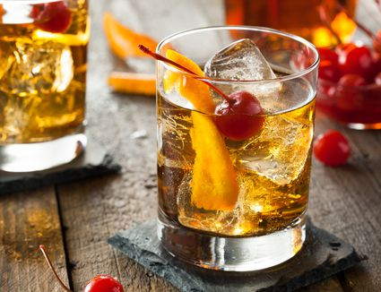 An old fashioned cocktail with cherries