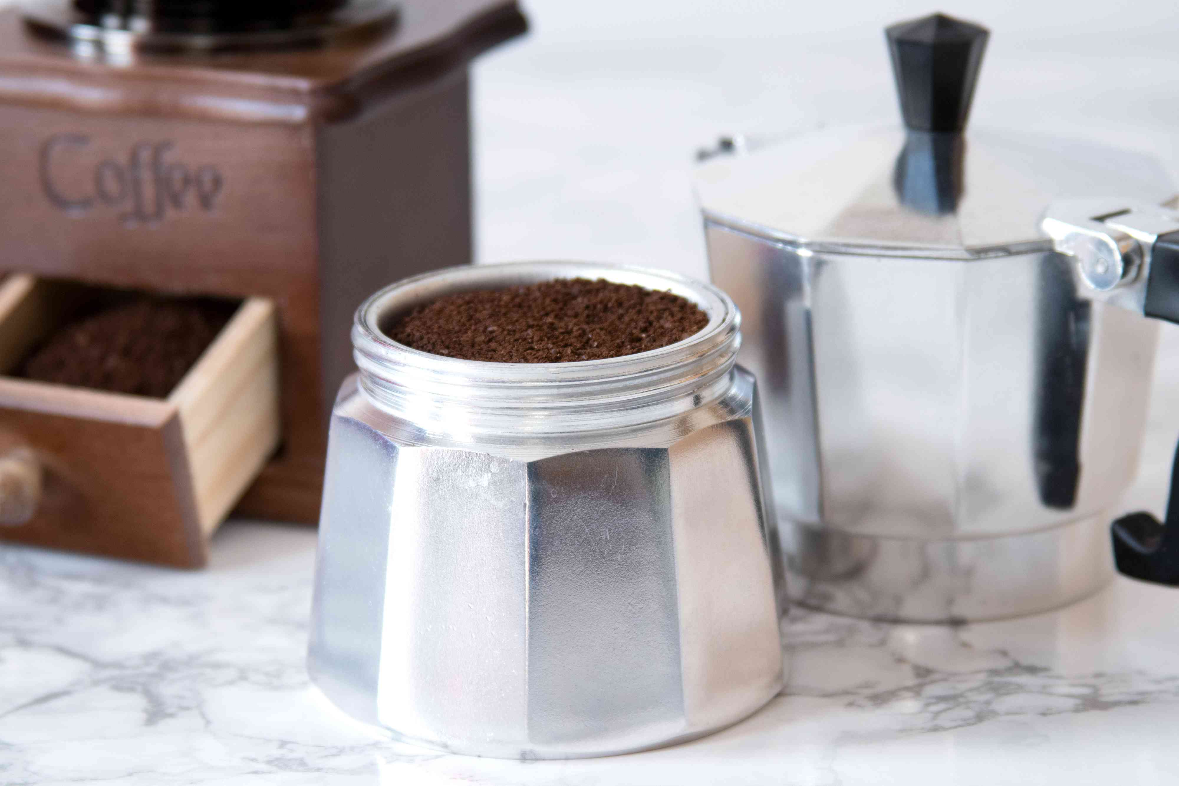 Filling Moka Pot With Finely Ground Coffee